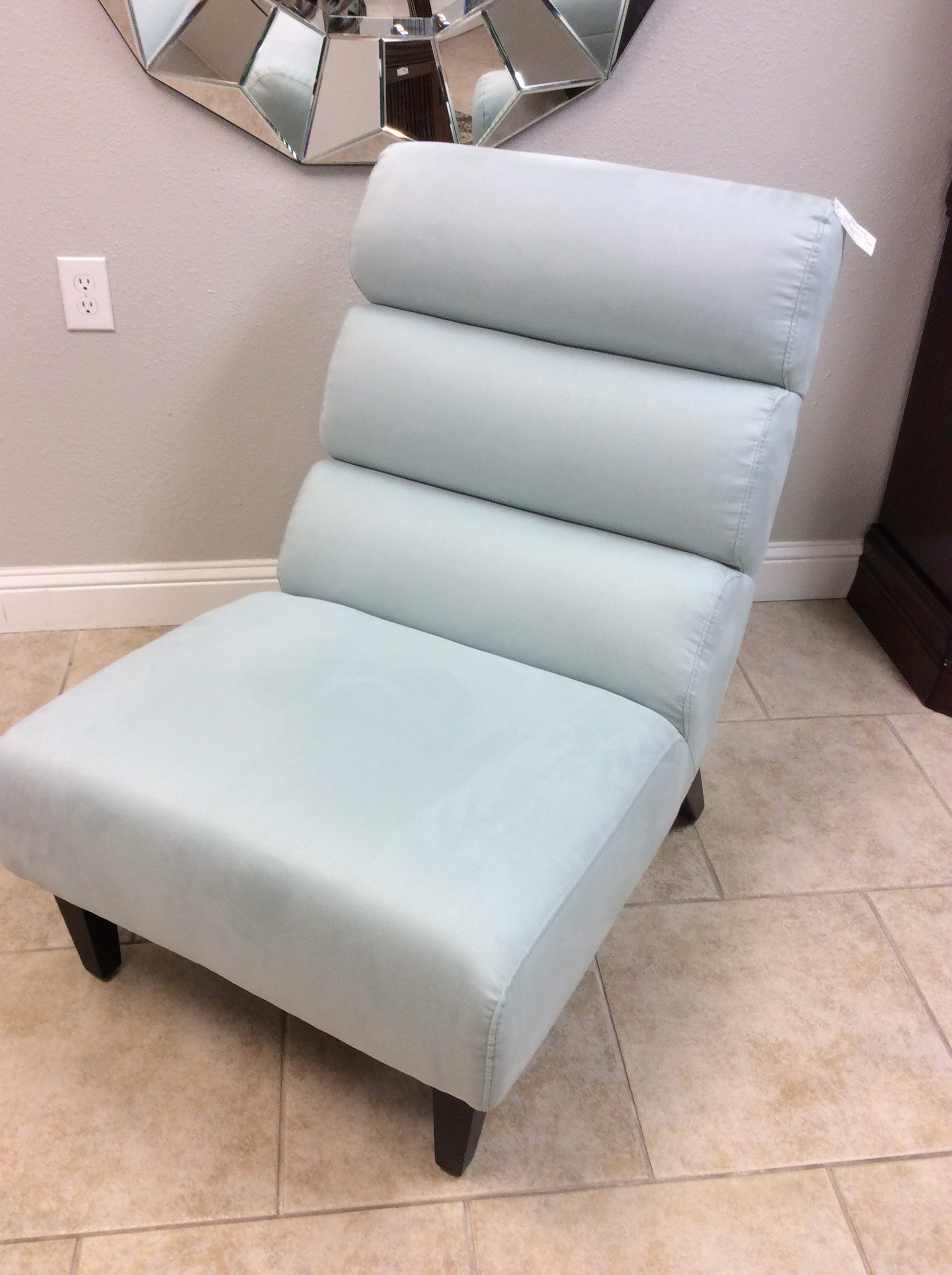 Love the baby blue color of this accent chair!<br /> Will blend in beautifully with almost any decor. The fabric is a very pale cool blue microfiber suede. It has a rolled back and sits on dark wood legs. This is a very comfortable chair.....