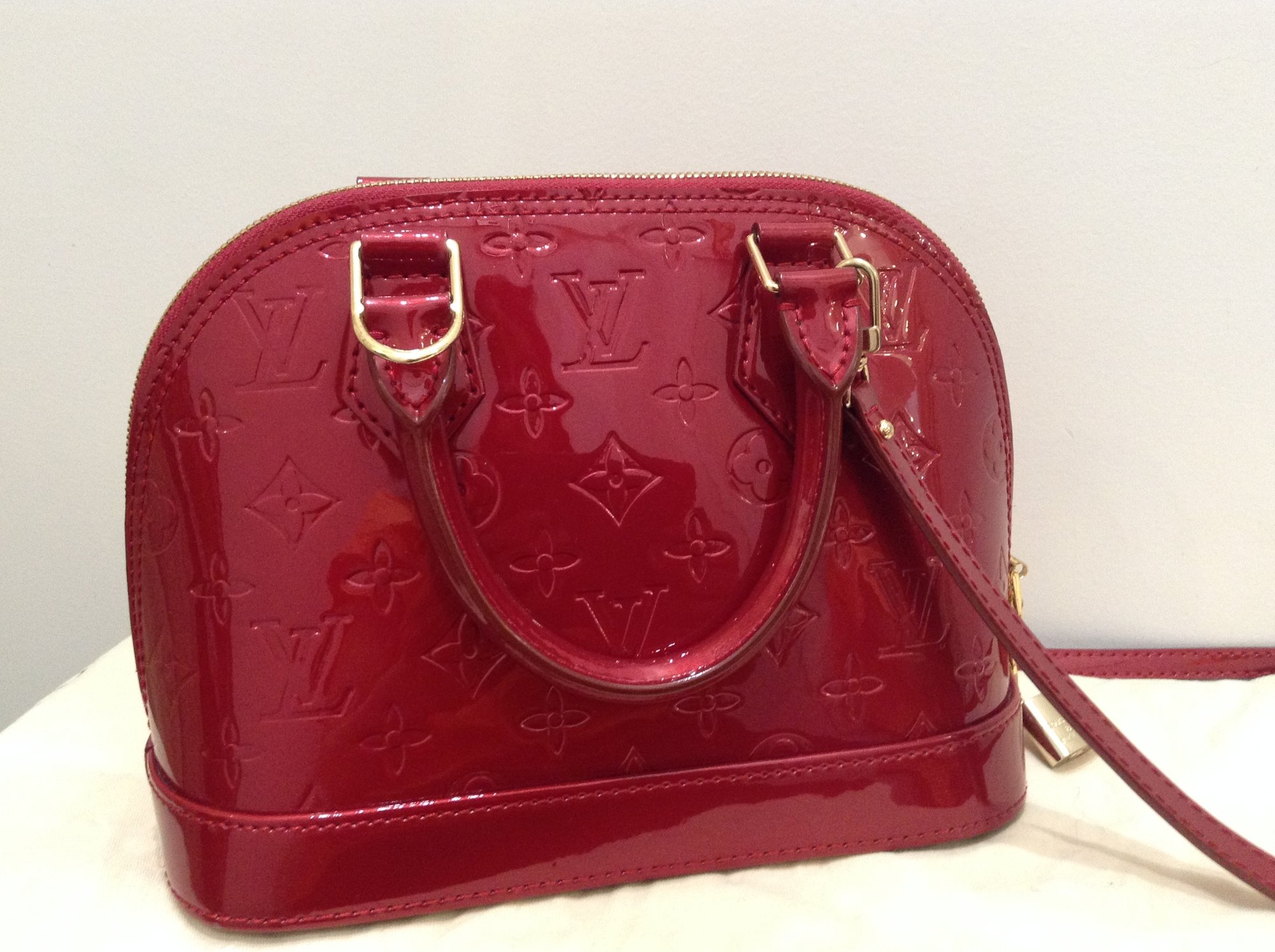 LOUIS VUITTON<br /> Authentic - with reciept<br /> Patent Logo Purse + Strap<br /> Red<br /> Size: Small