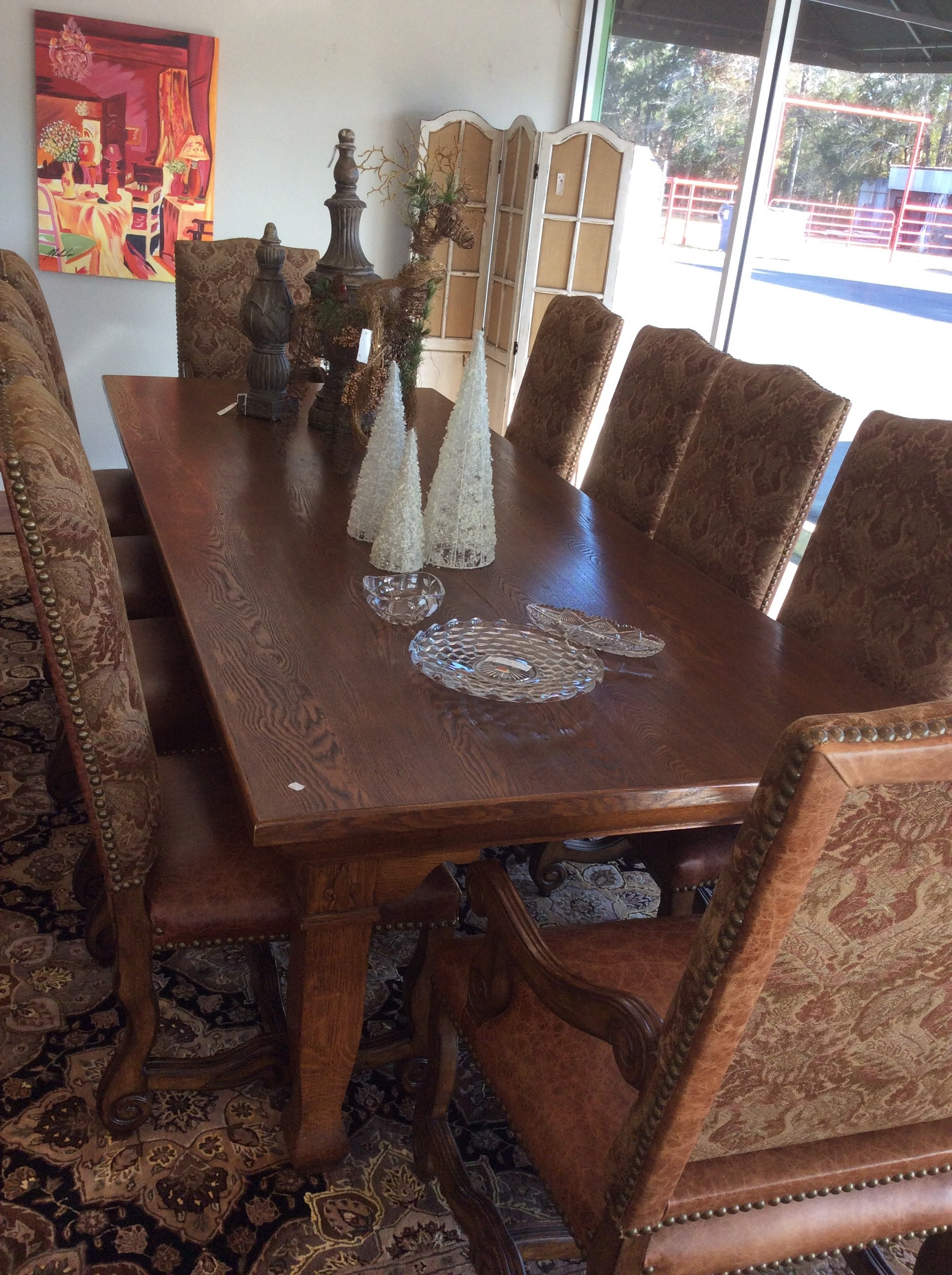 Now this is a truly stunning dining room set! The solid oak table is extra long (10 ft) and extra wide (more than 4 ft). The ETHAN ALLEN chairs are in excellent condition and feature leather seats, upholstered backs and beautiful nailhead accents. GORGEOUS!