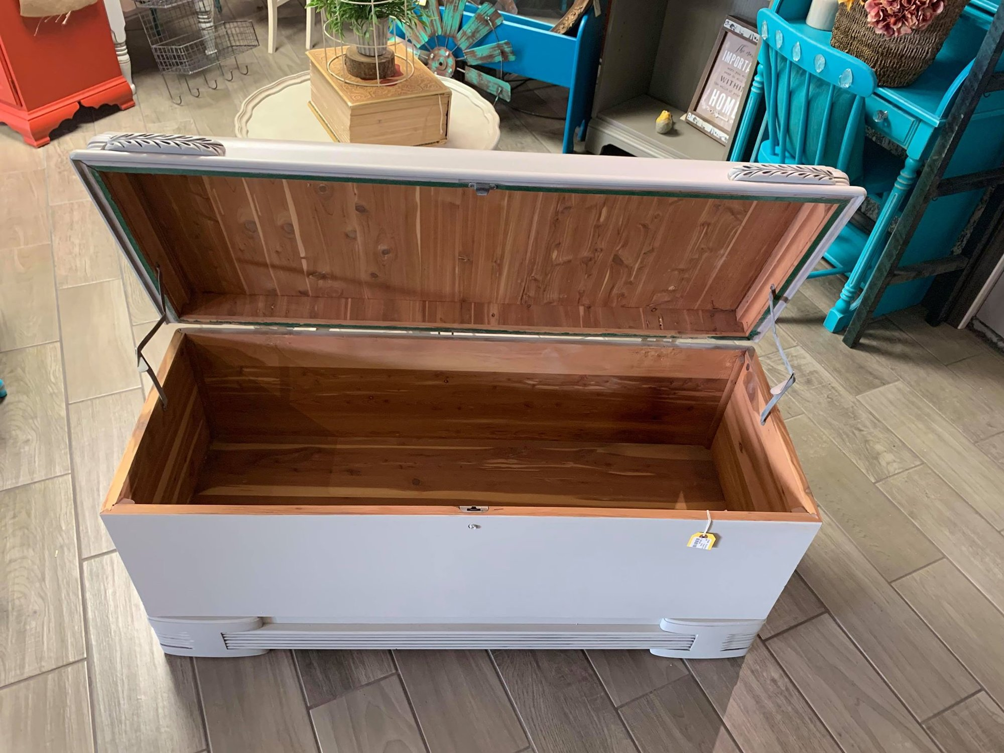 Vintage Art Deco Hope Chest<br /> This is a vintage cedar hope chest that is an art deco style. It has been painted a light gray with antiquing on the handles. The interior of the chest has been left the natural cedar. Chest measures 48&quot; wide x 19&quot; deep x 22&quot; tall. Buzz on in to see it today!