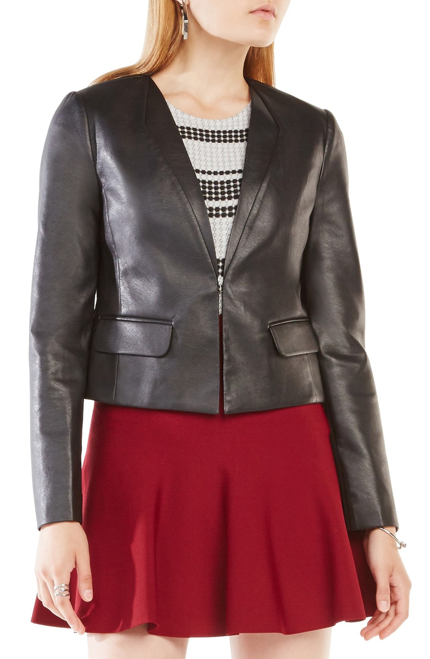 "BCBG like new condition Cruz Leather Jacket, Black, Size: Small<br /> <br /> ""An essential for all-season layering, this blazer-style faux-leather jacket has a posh lapel-stitched neck, slight peplum waist and stretchy ponte-knit panels that allow for more freedom of movement.<br /> <br />     Front hook-and-eye closure.<br />     Plunging V-neck.<br />     Long sleeves.<br />     Faux front flap pockets.<br />     Lined.<br />     100% polyurethane faux leather; 65% rayon, 30% nylon, 5% spandex ponte.<br />     Dry clean.<br />     By BCBGMAXAZRIA; imported.""<br /> <br /> Photo and description credits: nordstrom.com"