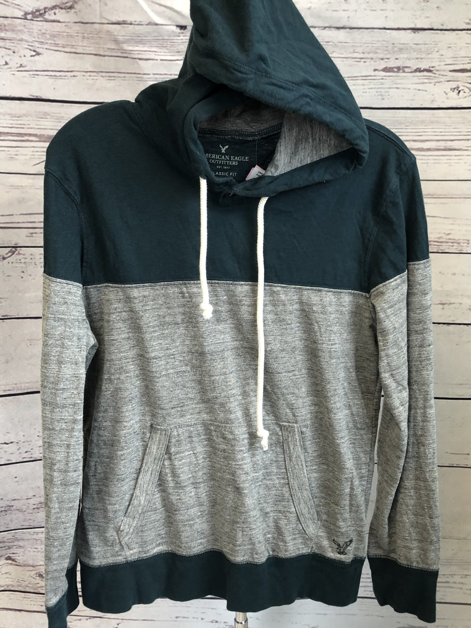 American Eagle with hood and 1 button by the neck.