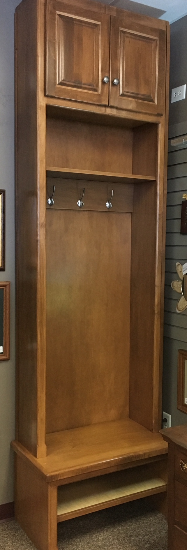 Custom built entry way cabinet.  Perfect for storing hats, mittens and boots.  Several hooks for your coats.
