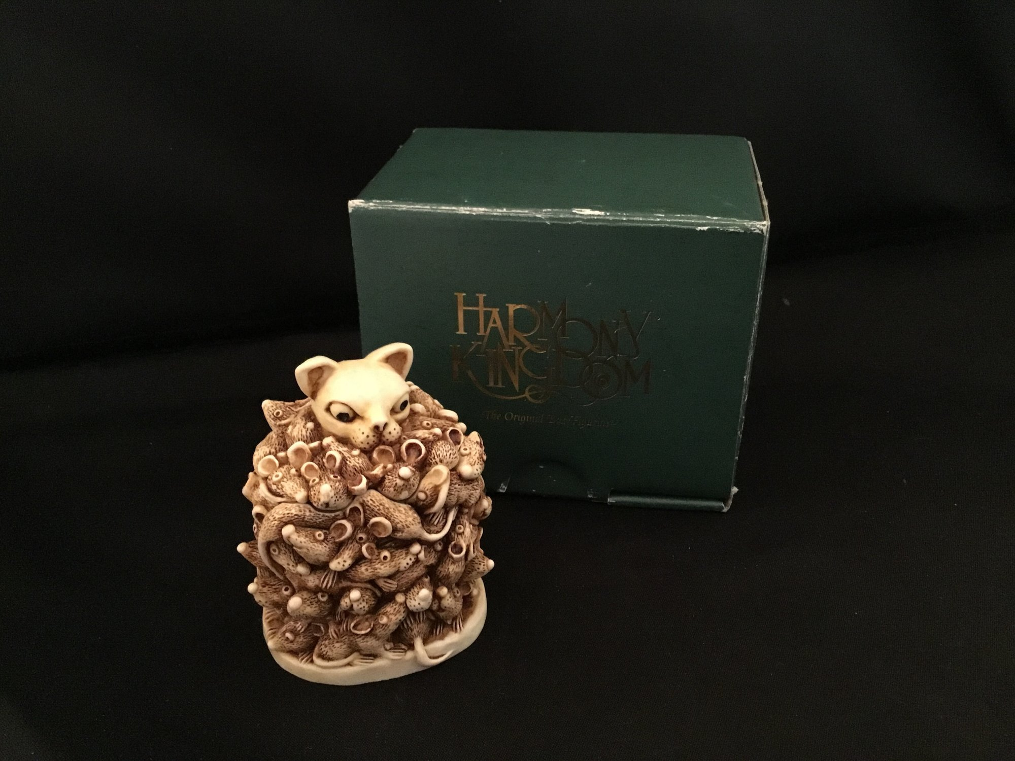 Too Much Of A Good Thing is a Harmony Kingdom box figurine made of crushed marble in the UK.  This piece depicts a cat enveloped in mice.<br /> 2 1/4&quot; tall<br /> 2&quot; wide