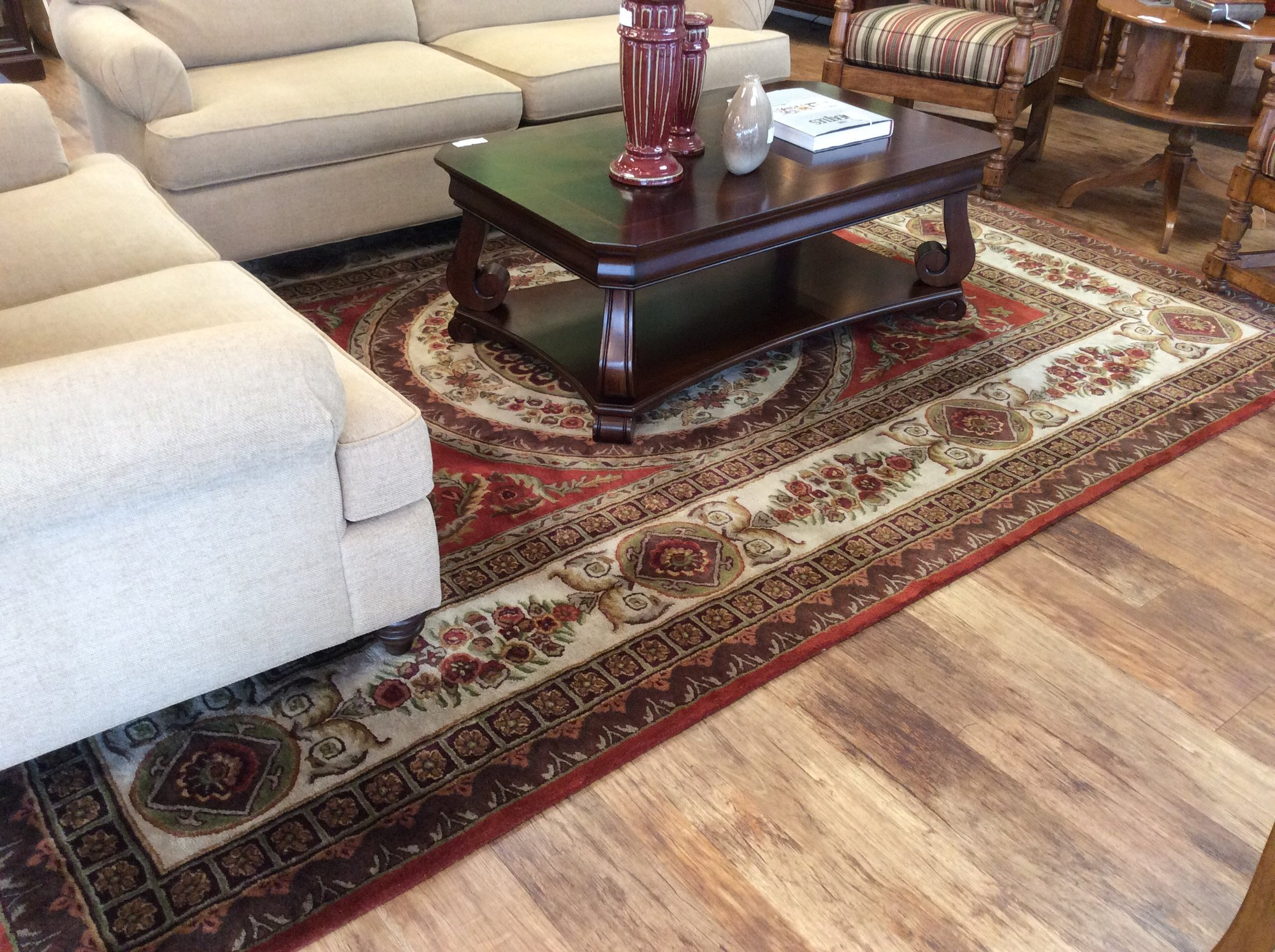 This rug is priced to move at only $225! That is a real bargain, isn't it? If you like reds and need a good sized (8'x12.3') rug somewhere, this one may be for you. The owner recently had it professionally cleaned, and some people think there is a bit of a chemical smell to it. Come smell it for yourself!