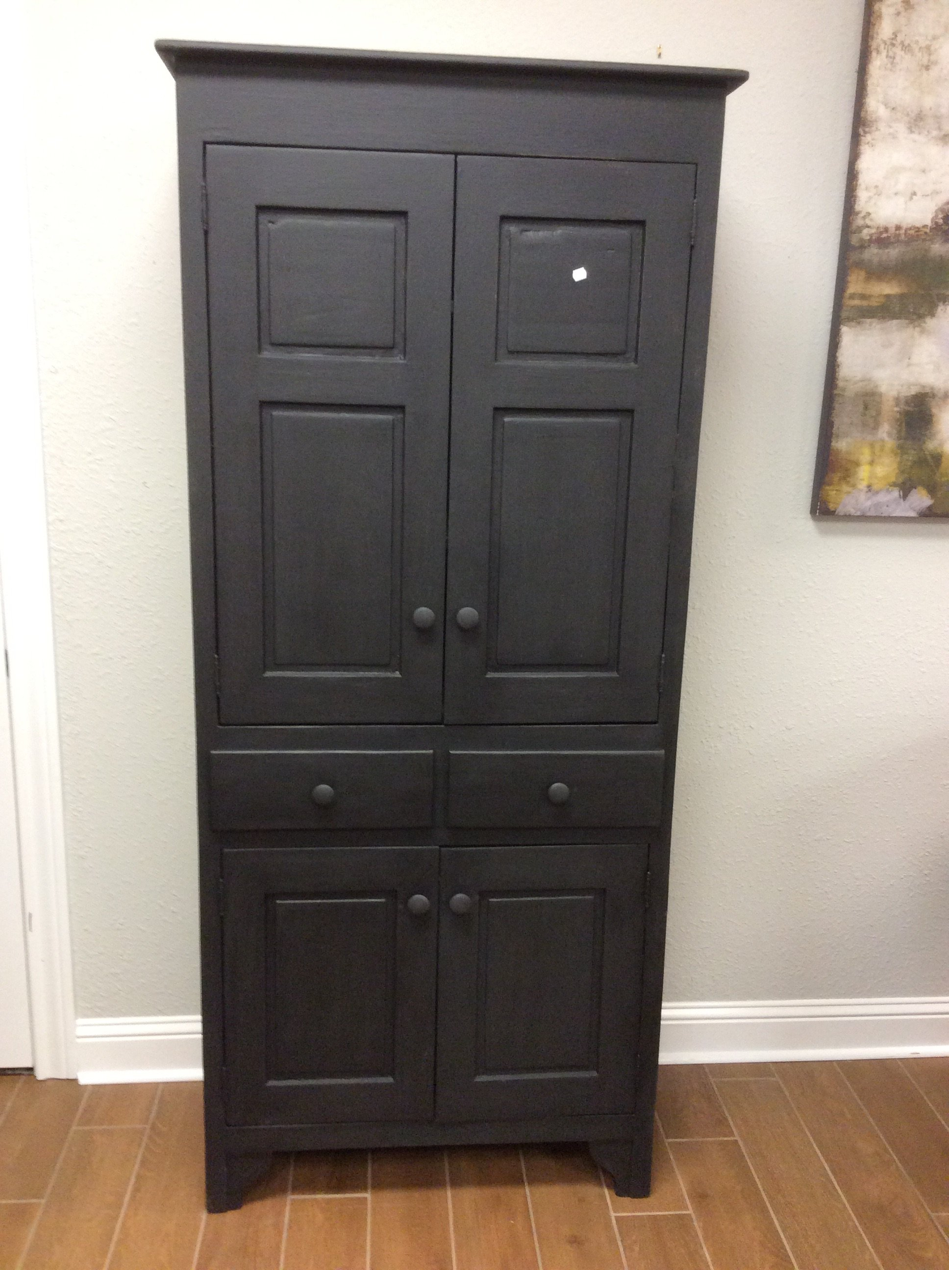 "Tall at 79"" and painted black, this cabinet may be the focal point of the room. It features alot of storage space with adjustable shelving  and 2 drawers."