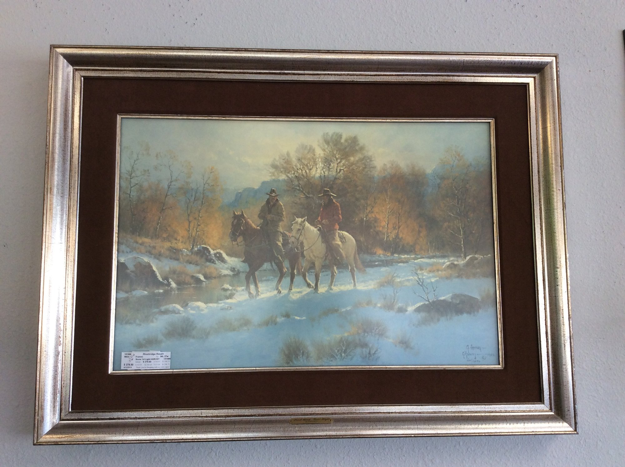 Gorgeous! This picture is matted and  framed, numbered, signed and comes with a Certificate of Authenticity. What a package! G harvey is known for his western scenes and this one is a beauty. Matted in a soft brown suede with a subtle slivery distressed frame, your eye is automatically drawn to the image. Hard to tell if it's dawns early light or a peaceful sunset, either way you need to come in and take a look!