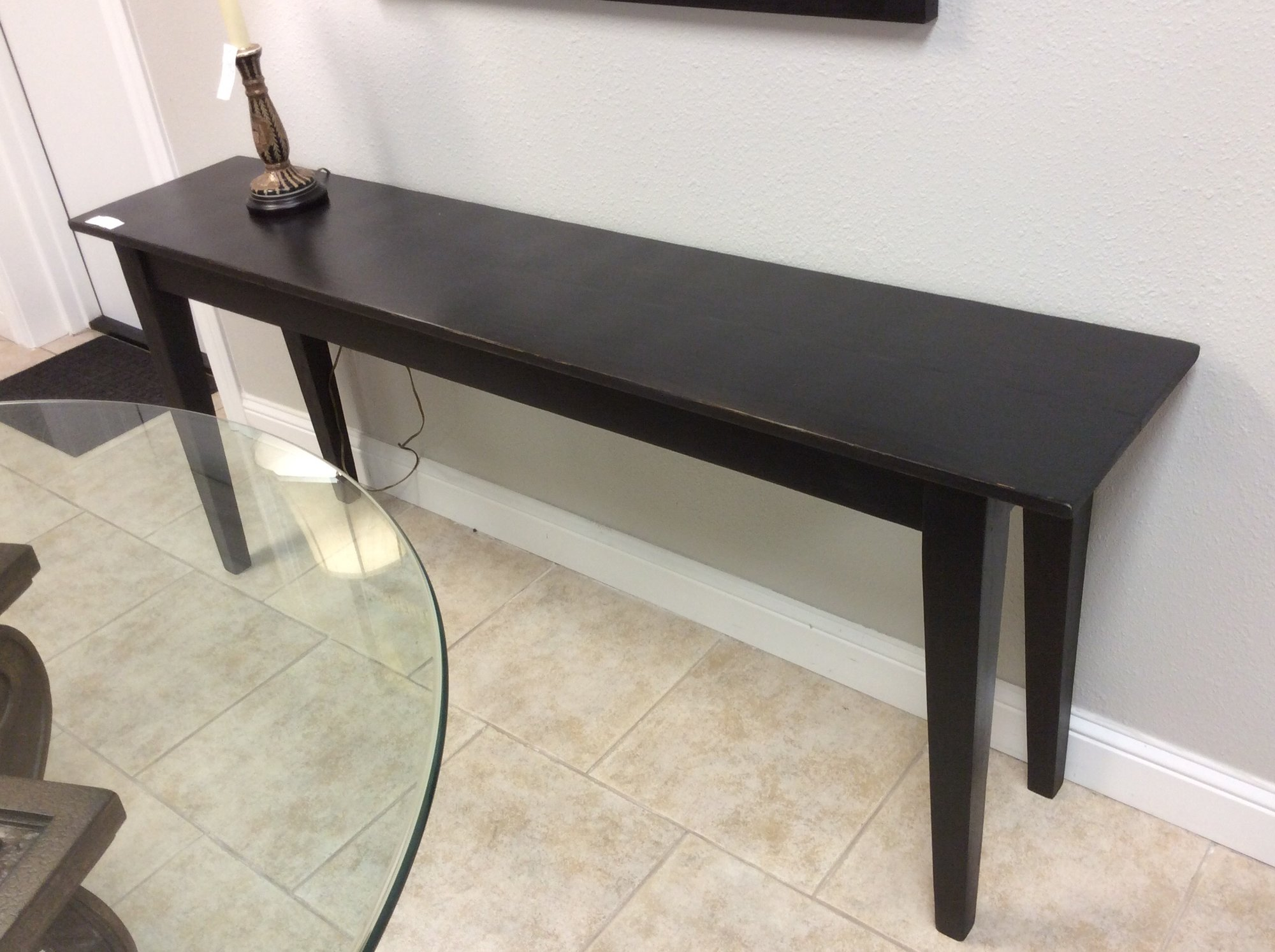 This CUSTOM beauty is solid wood and has a painted matte black finish. It is both sleek and simple. We actually have FOUR of these tables available for sale. The remaining ones are all different shades of matte gray.