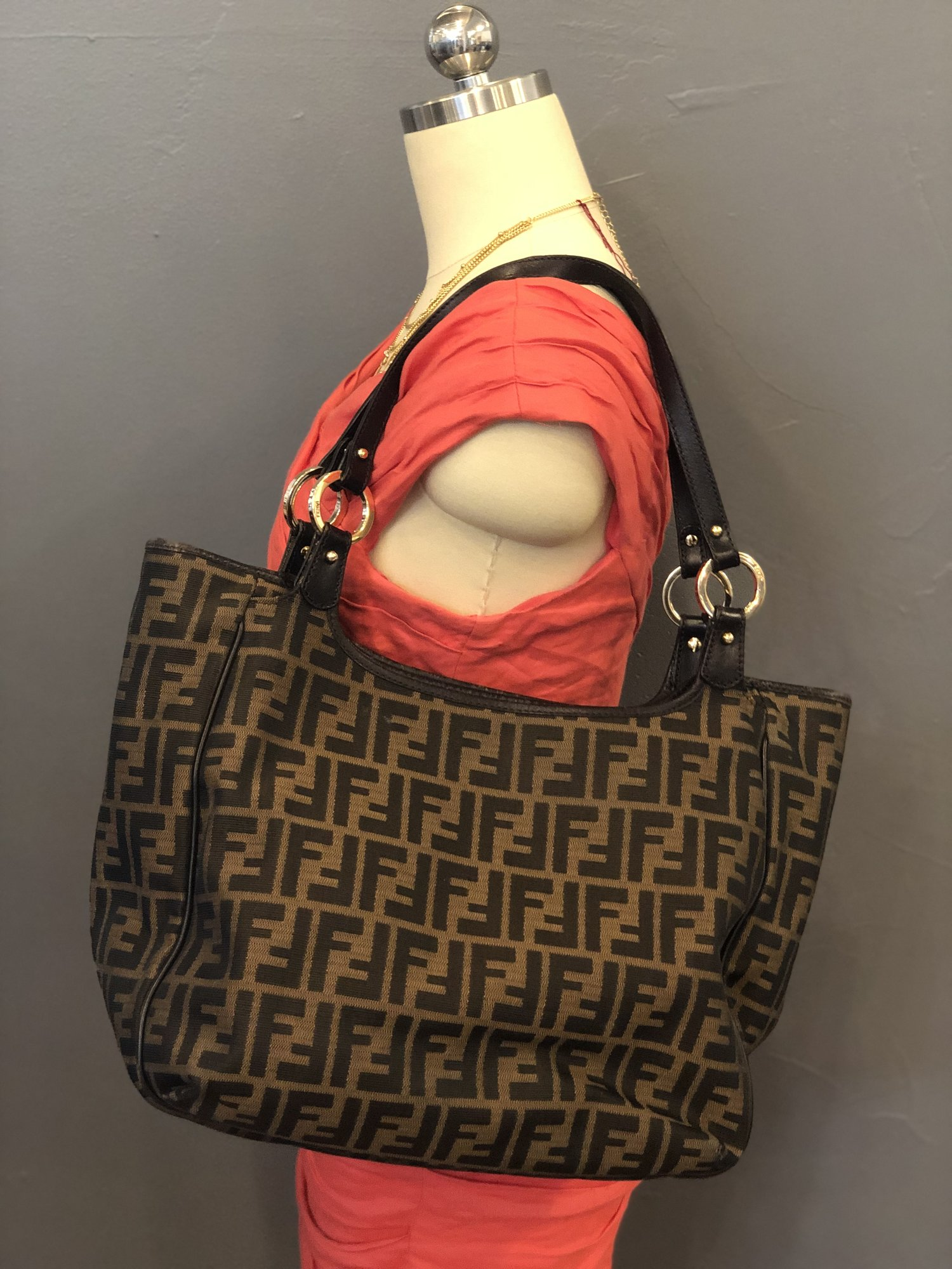 "Fendi Zucca Tote, Brown, Size: M<br /> <br /> Condition: GOOD. Some wear/cracking on leather trim<br /> <br /> 10""H x 13""W x 5""D<br /> 10"" strap drop"