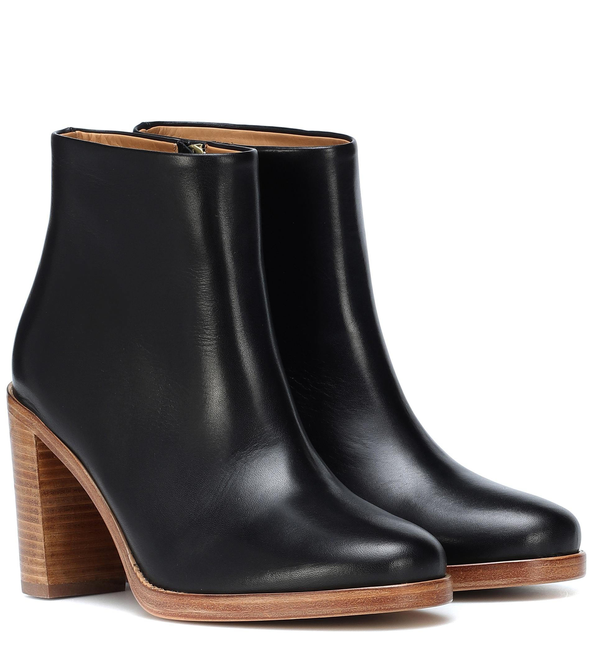 "APC Chic Leather Ankle Boots, Black, Size: 37, gently worn - scuffs on bottom, not on exterior.  Orig. rtl: $530<br /> <br /> ""A perennial silhouette, the Chic ankle boot's understated name says it all. The style from A.P.C. is crafted from smooth black leather with a brown leather sole and a stacked heel – a fuss-free silhouette with endless styling possibilities. Wear yours with everything from maxi-length dresses and long-line coats, to cropped denim and bomber jackets.<br /> <br />     upper: cow leather<br />     sole: leather insole and sole""<br /> <br /> Photo and description credits: myresa.com"