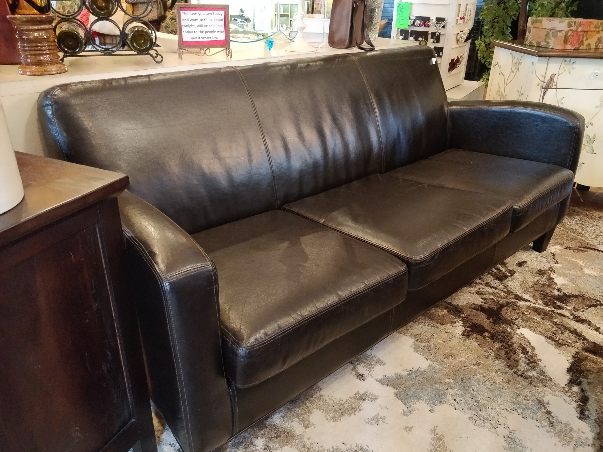 "Brown leather couch<br /> Size: 30""W x 72""L"