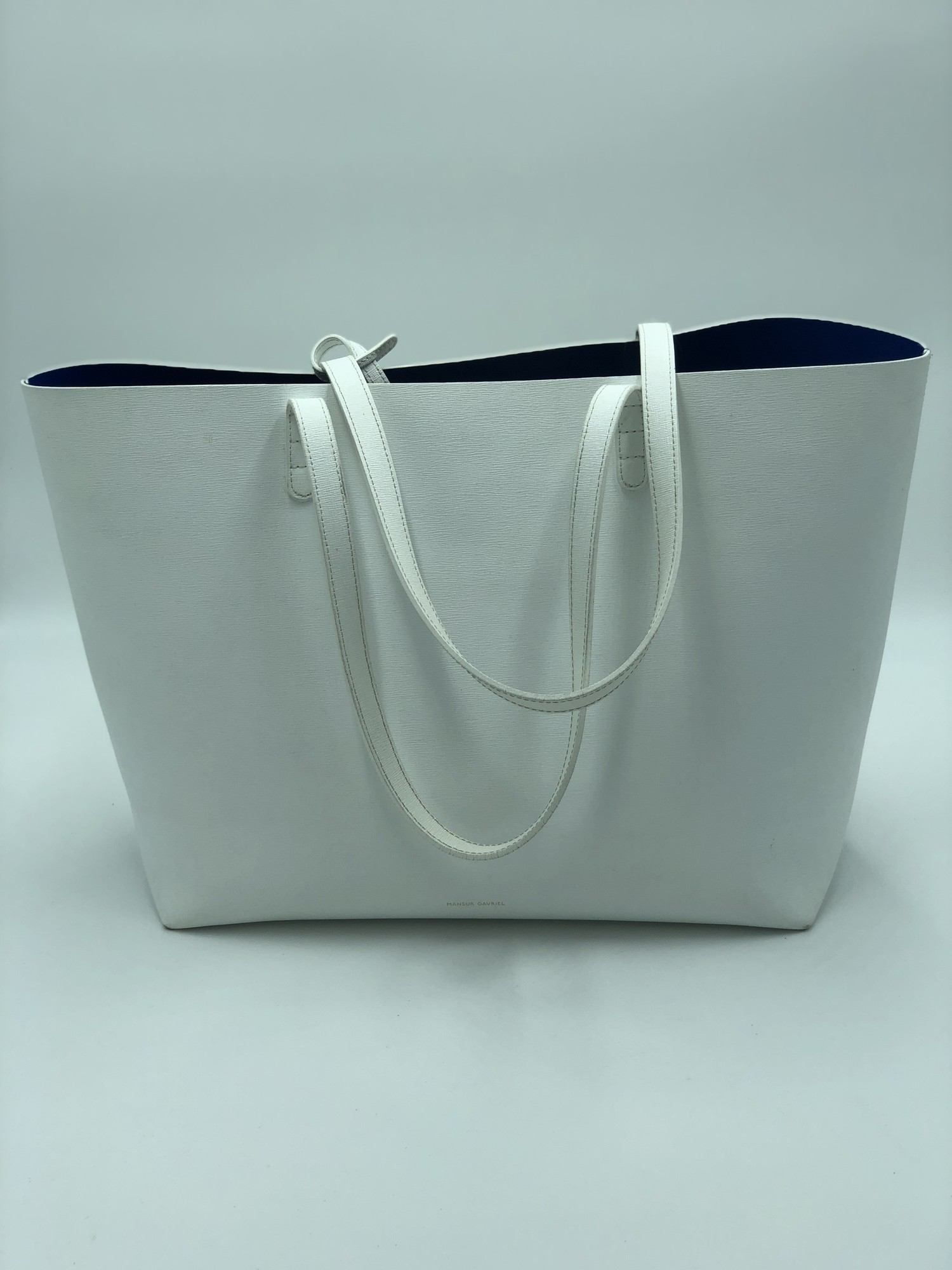 "Mansur Gavriel Tote, White, Size: L<br /> <br /> Condition: GOOD. Normal wear on bottom seams<br /> <br /> 11.5"" H × 19.5""W × 6""D<br /> <br /> Original Retail: $615<br /> <br /> We guarantee the authenticity of every bag on our site. Each bag comes with either an original sales receipt or a Certificate of Authenticity from AuthenticateFirst.com. Established in 2013, AuthenticateFirst.com<br /> (http://authenticatefirst.com) is one of the premier authentication services in the US, providing authentications of designer handbags, wallets, small leather goods, footwear, jewelry, and accessories. They employee in-house experts who have decades of experience working with hundreds of luxury brands."