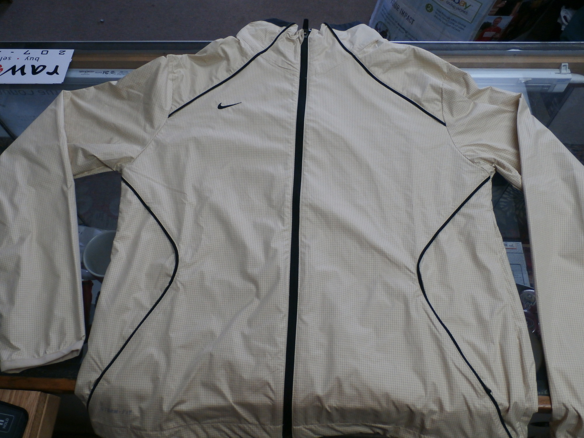 "Nike Storm-Fit Women's Jacket size Large Gold #32737<br /> Rating:   (see below) 2- Great Condition<br /> Team: N/A<br /> Player:  N/A<br /> Brand: Nike<br /> Size: Women's   Large(Measured Flat: across waist 21"", length 26"" )<br /> Measured flat: armpit to armpit; top of shoulder to the bottom hem<br /> Color: gold<br /> Style: long sleeve; full zip; jacket; has pockets ;<br /> Material:   100% polyester<br /> Condition: - 2- Great Condition - wrinkled; minimal flaws;<br /> Item #: 32737<br /> Shipping: FREE"