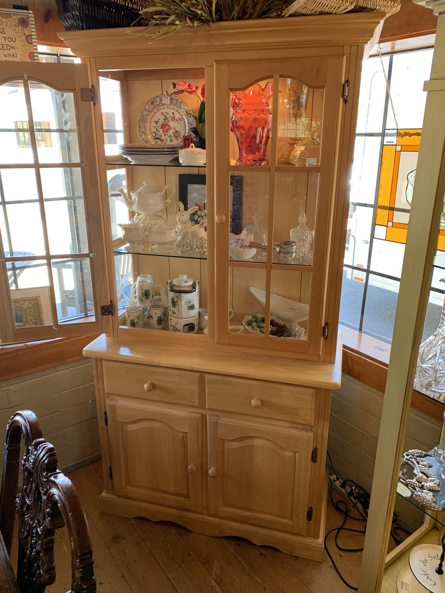 Very cute hutch that breaks into two pieces for easy moving. The cabinet lights up as well.