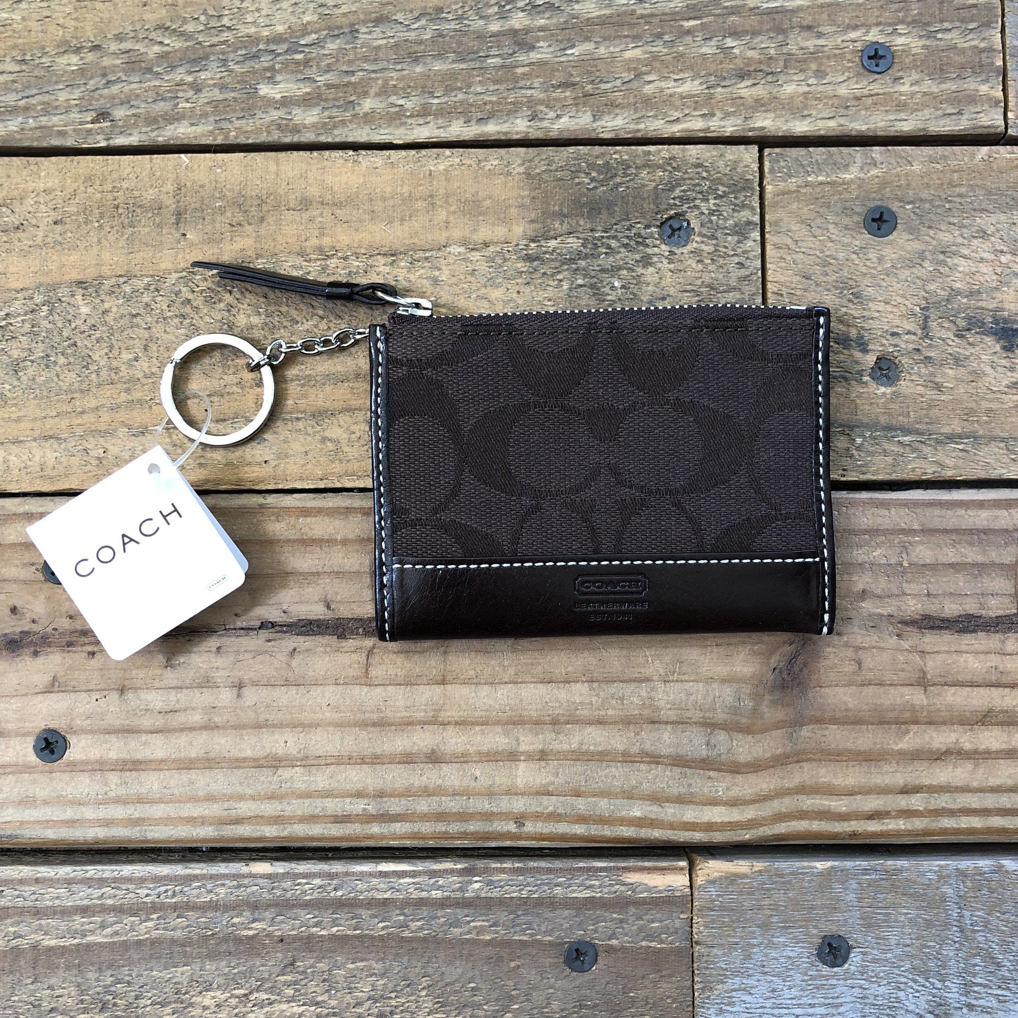 "NWT Coach Mini Wallet<br /> Color: Browns<br /> Size: 4.5"" x 3""<br /> Material: Fabric & Leather"