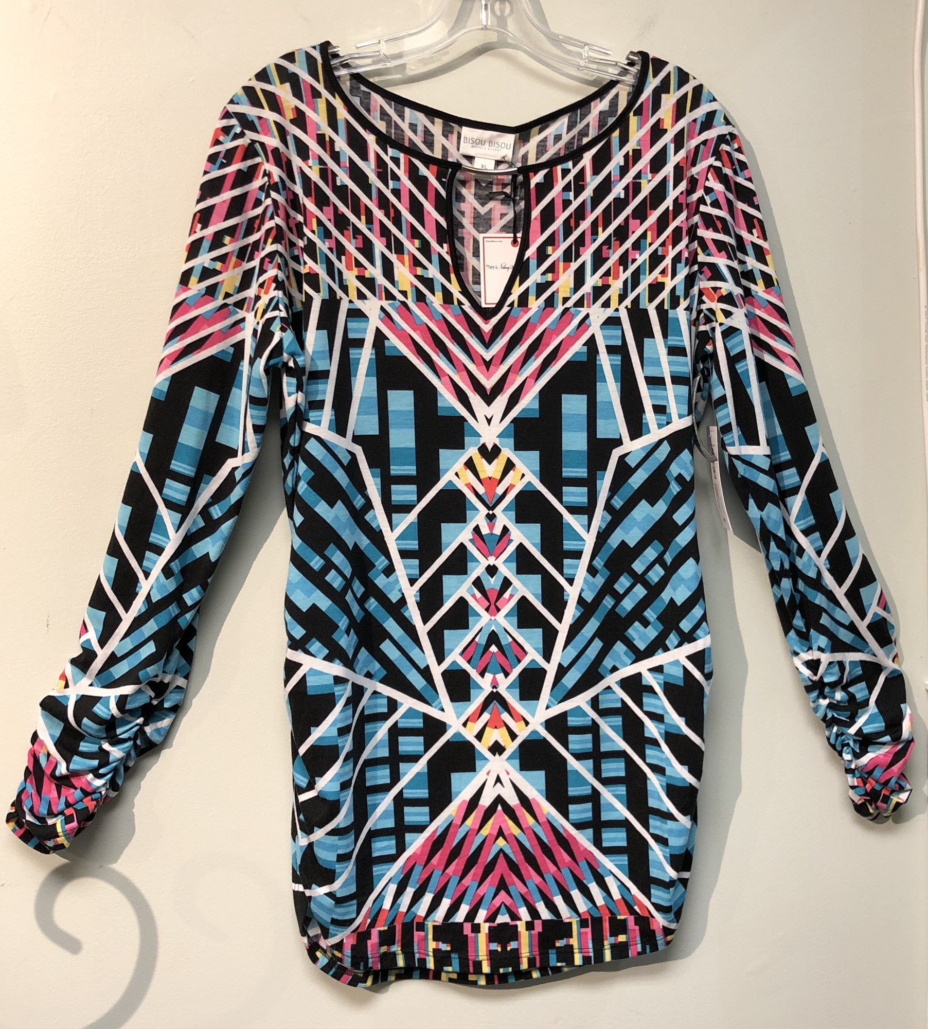 Bisou Bisou Top/Tunic<br /> Size: XL<br /> Color: Multi<br /> Style: Tunic length, long sleeves<br /> NWT<br /> Please see photos for material and care instructions