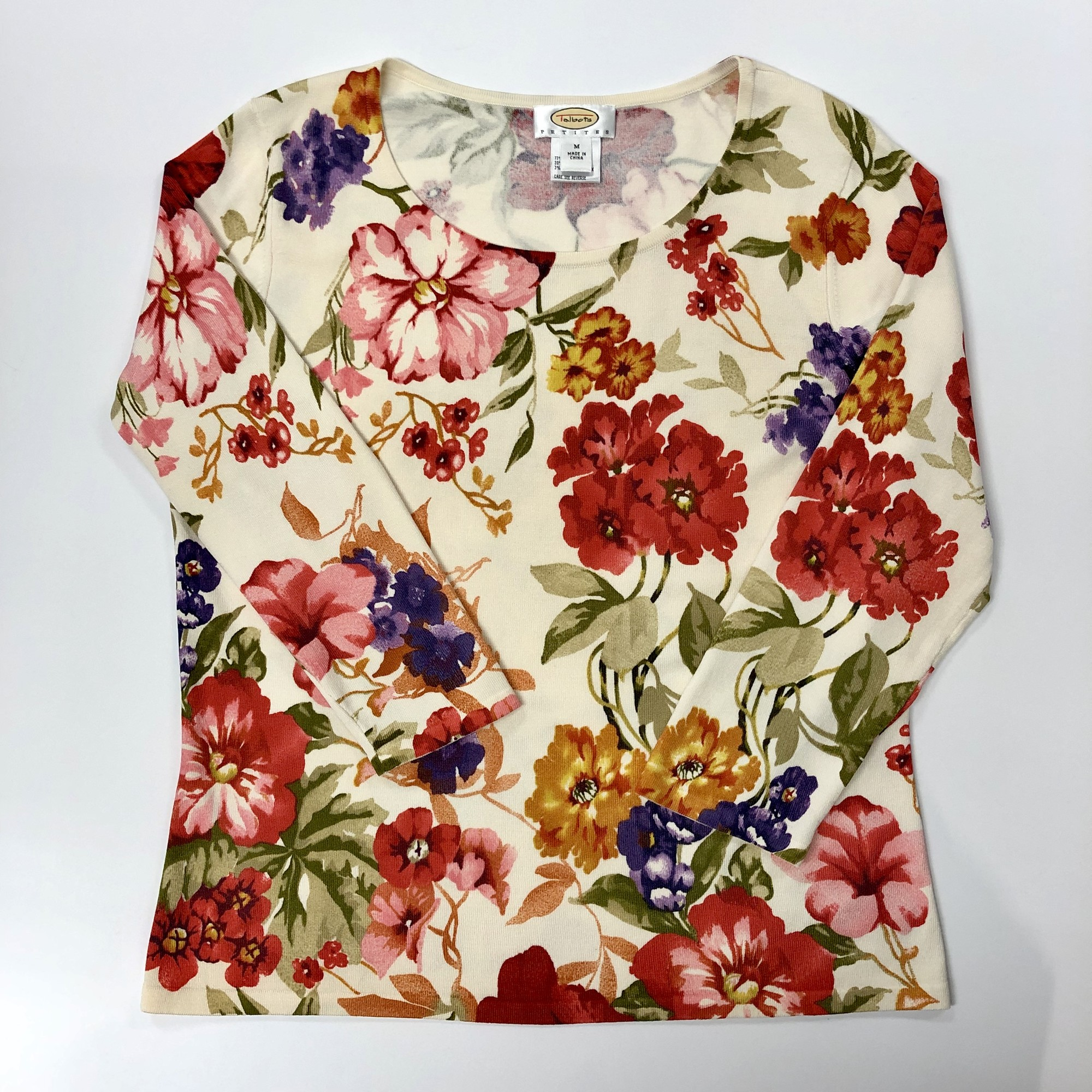 Talbots Top<br /> Design: Floral<br /> Colors: Light beige background, flower colors are reds, pinks, purples, orange, yellow, greens<br /> Size: Medium Petite<br /> Please see photos for material & care instructions
