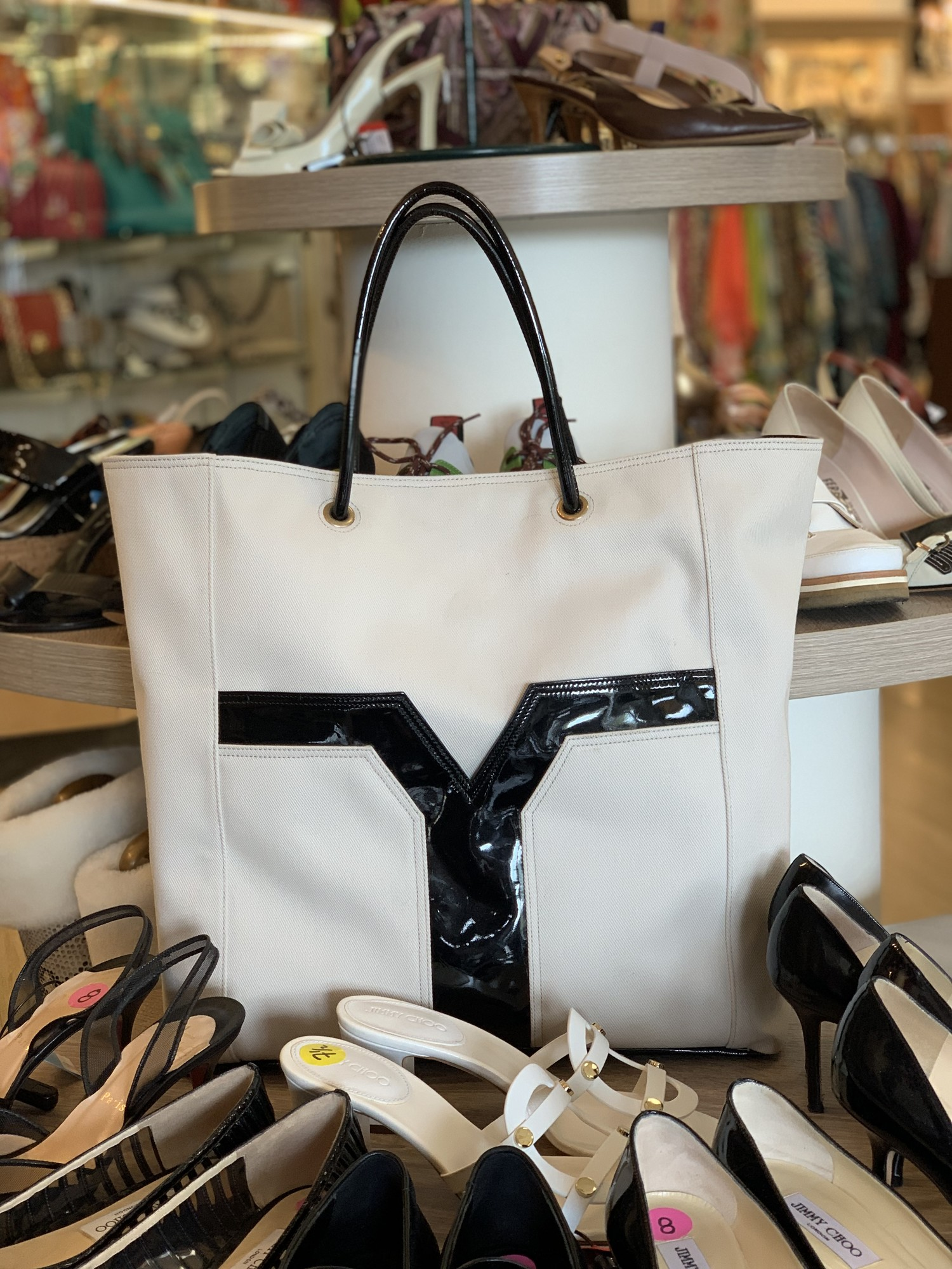 YSL bone colored canvas and black patent tote<br /> <br /> good condition, some small marks