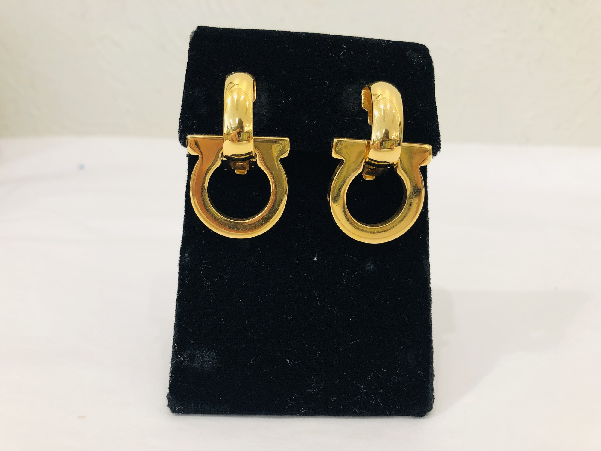 Ferragamo goldtone clip earrings<br /> <br /> Ferragamo logo, super cute!