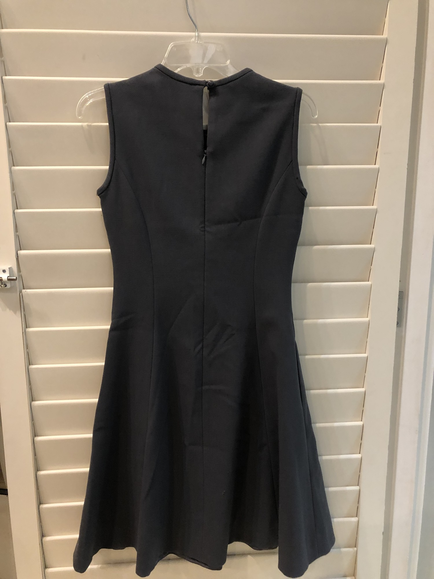 Kate Spade, Gray sleeveless dress.  Gathering around neckline and darted bustline lend much visual interest to this classic piece.  Figure flattering cut. Size: 4