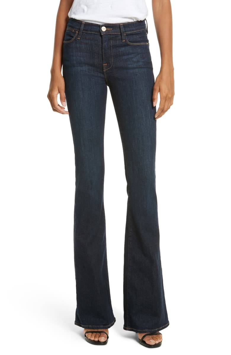 "Frame Le High Flare Jeans, Denim, Size: 29, EUC orig. rtl: $209<br /> <br /> ""These high-waisted FRAME jeans have a flared profile and a hint of whiskering. 5-pocket styling. Single-button closure and zip fly.<br /> <br /> Fabric: Stretch denim.<br /> 94% cotton/5% polyester/1% spandex.<br /> Wash cold.<br /> Made in the USA.<br /> <br /> Measurements<br /> Rise: 9.75in / 25cm<br /> Inseam: 34.75in / 88cm<br /> Leg opening: 19.75in / 50cm<br /> Measurements from size 27""<br /> <br /> Photo and description credits: shopbop.com"