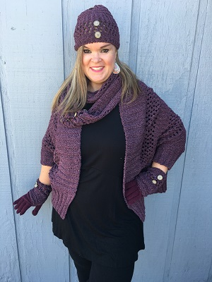 "Tonya looks amazing in our Simply Noelle Hat. This goes perfect with our Simply Noelle Warp and Scarf (sold separately).  Soft, Heathered, Open Weave, Chenille, Buttons. 8""W x 9""H<br /> 100% Polyester"