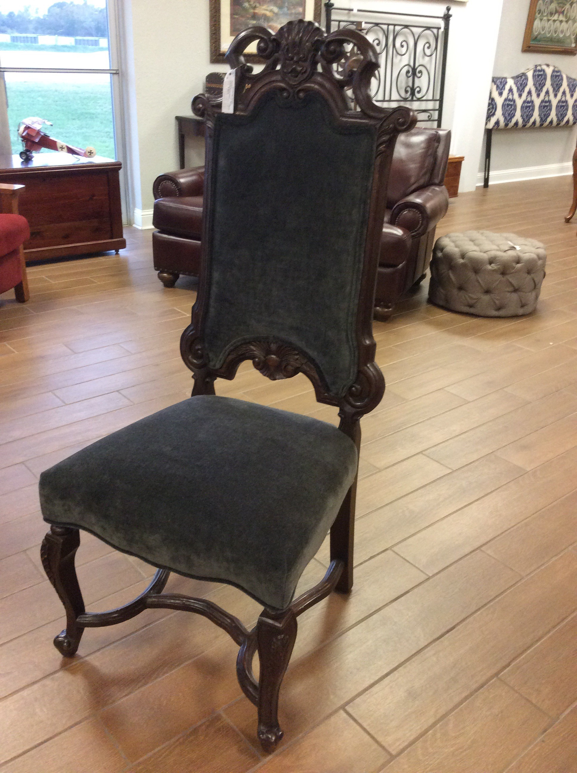 This set of dining room chairs, of which there are 6, are Baroque in style. Dramatic and commanding they feature detailed woodwork and are upholstered in a soft gray/blue velveteen. Great price at only $595 for the set!