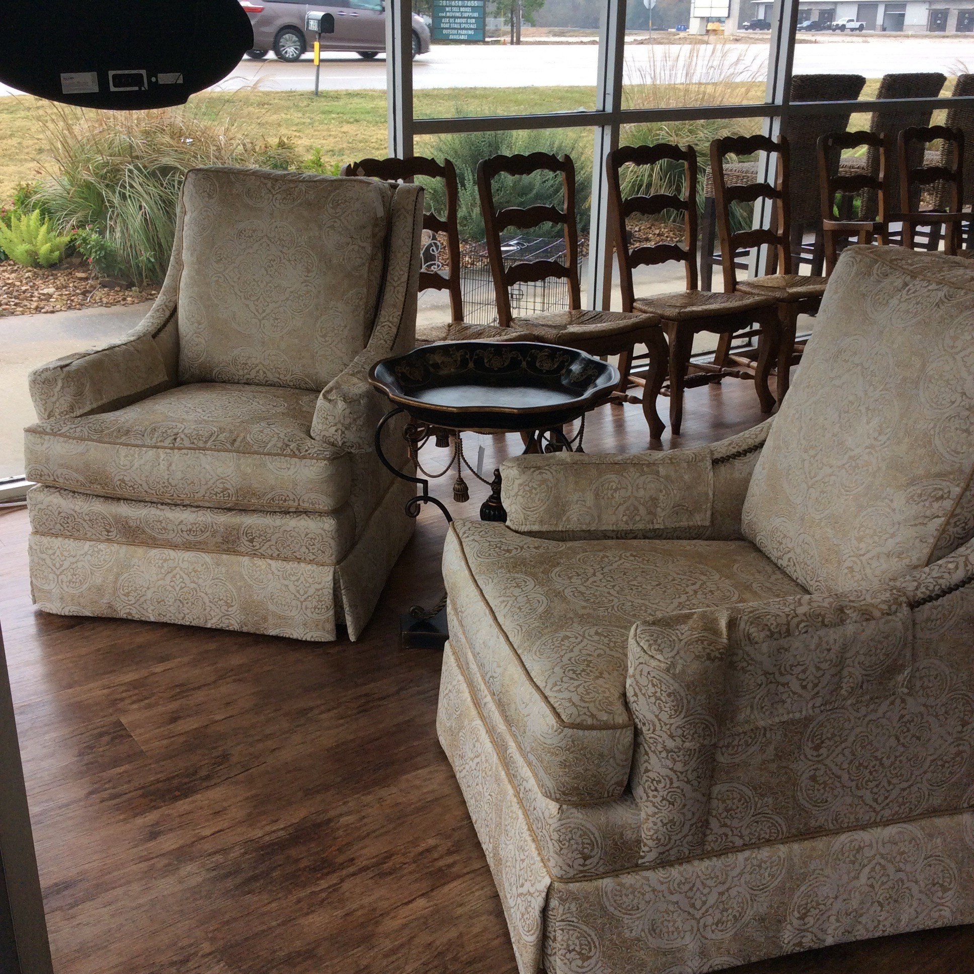This pair of upholstered chairs by Sherrill Furniture are in great condition! Upholstered in a gold, silver and cream brocade with a nailhead trim. Back cushions are attached. Classy and elegant!