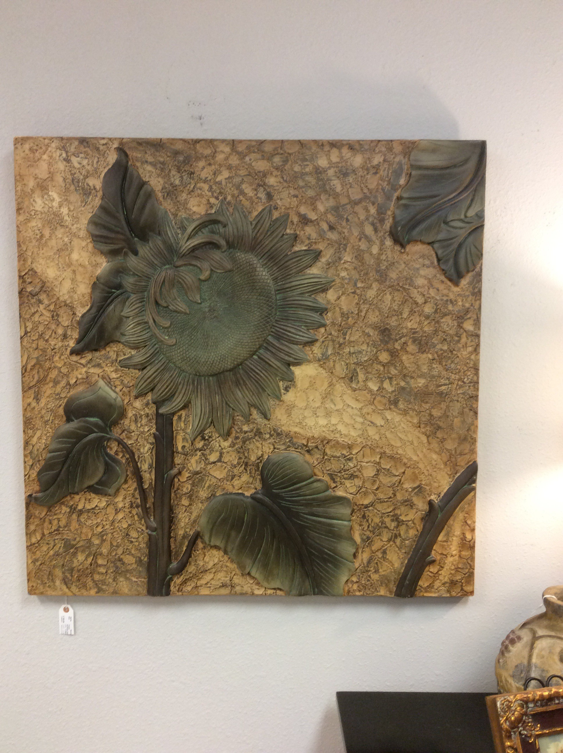 The larger-than-life sunflower which has been embossed gives you a 3 dimensional image. Wouldn't this be lovely in a Tuscan style home? The colors are earthy, really lovely.