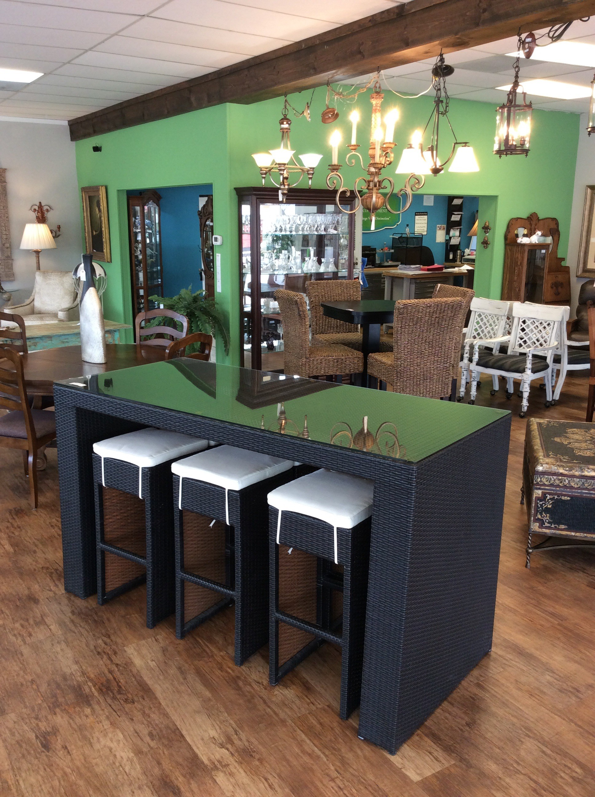This is a great outside set! This pub height table has a glass top and 6 matching stools that nest neatly beneath the table for easy storage. So it's a nice space saver! The stools are topped with a linen cushion, but they can be used with or without.