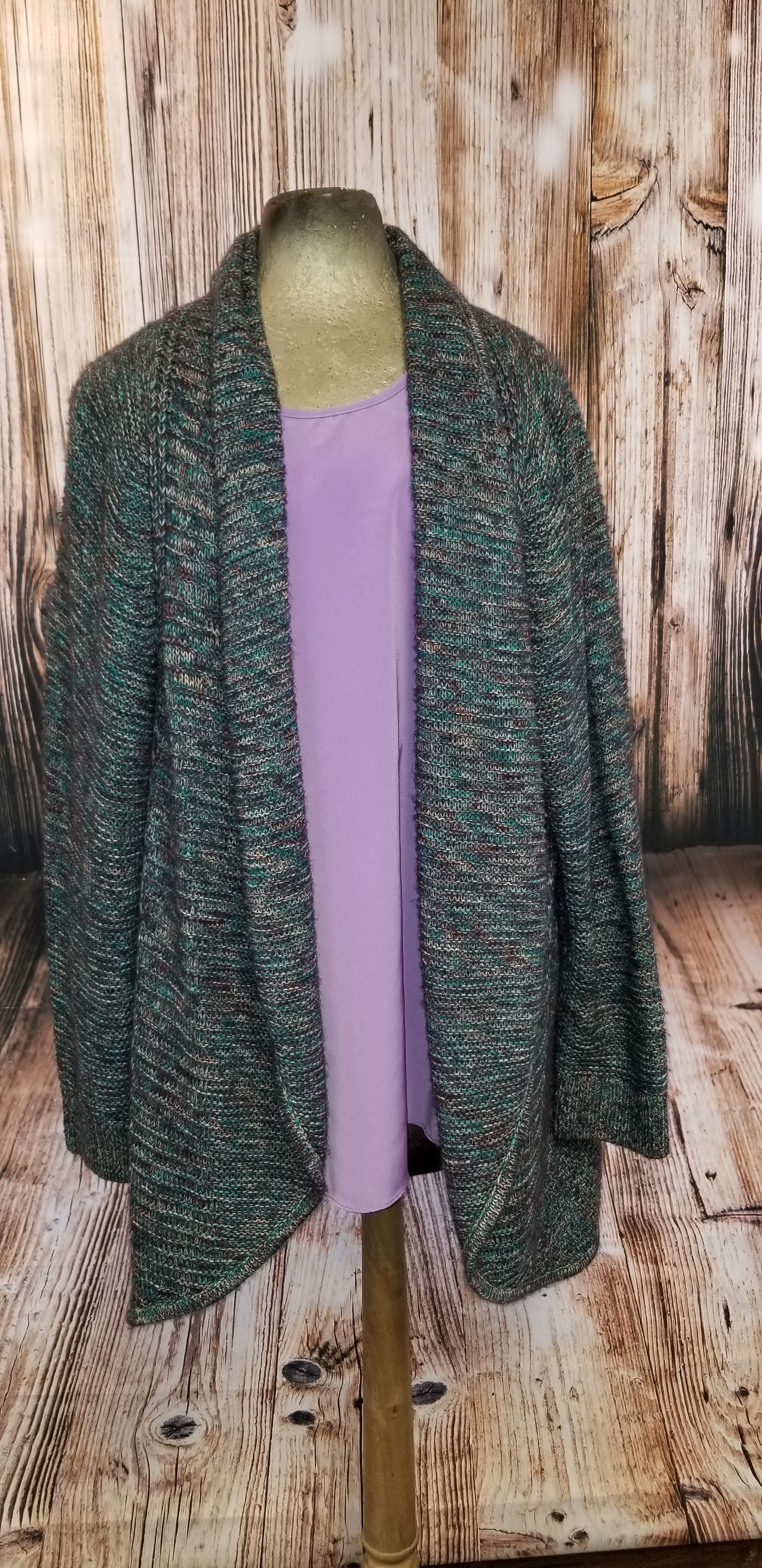 Beautiful Cardigan. Perfect for a cold winter's night. (Tank sold separately)