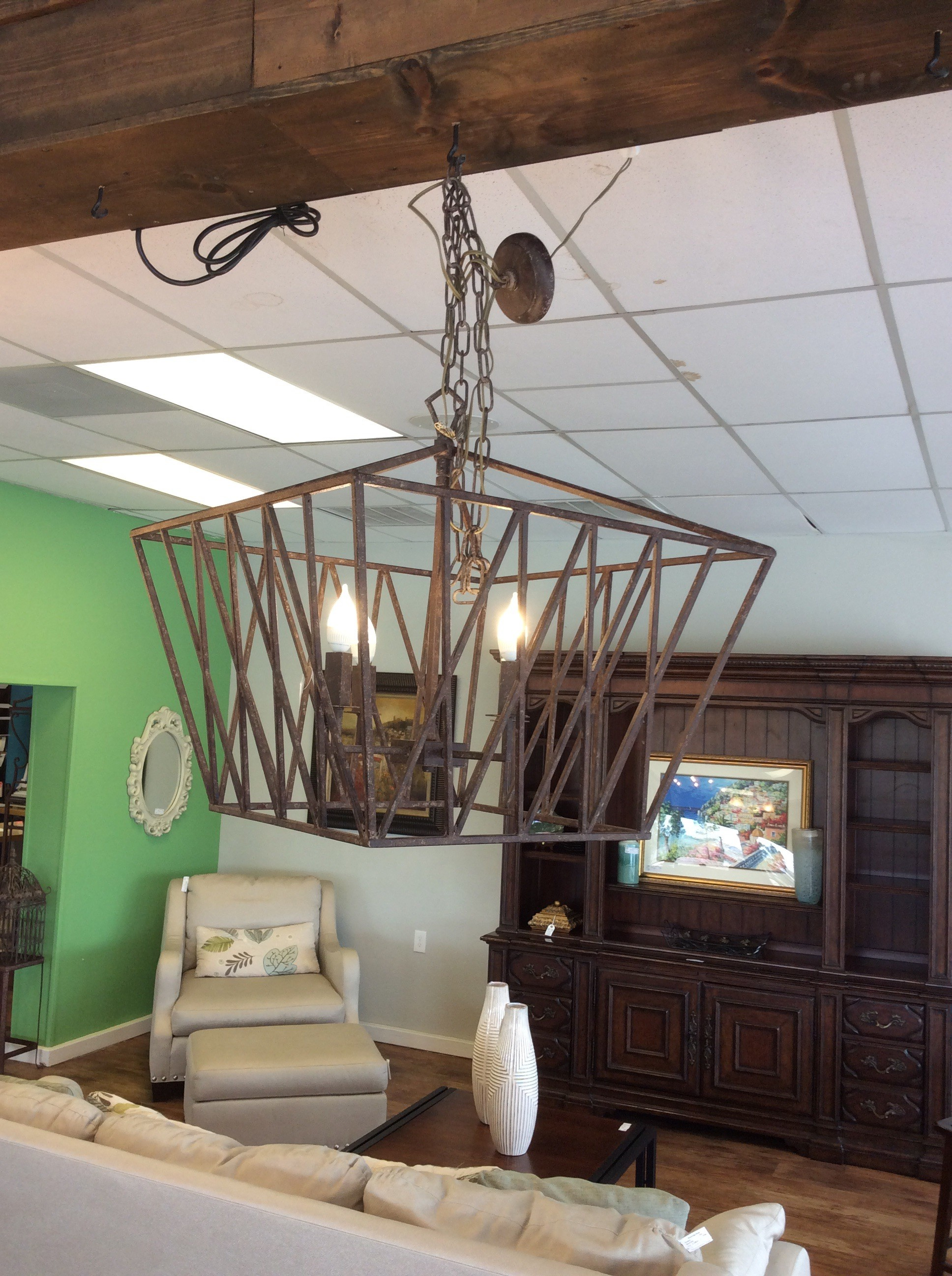 This is a lovely hanging light fixture. Constructed of metal which has been painted brown it is large,  contemporary in style and features 4 lights. This would be attractive used either inside or outside. Very farmhousy.