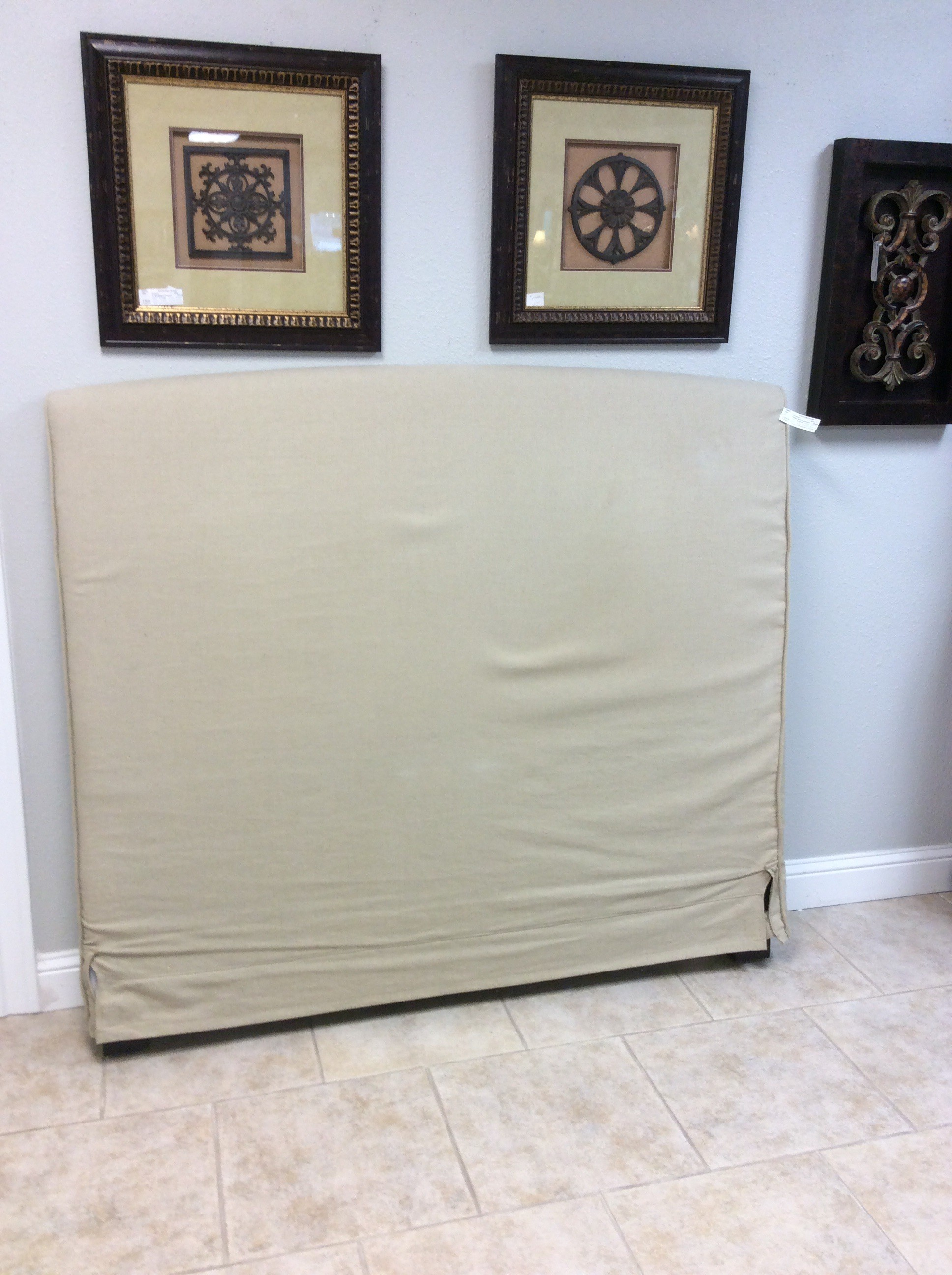 This headboard only is from Pottery Barn. Queen-size, it features a soft tan/khaki slipcover. Contemporary but neutral enough to fit well into many decorative styles.