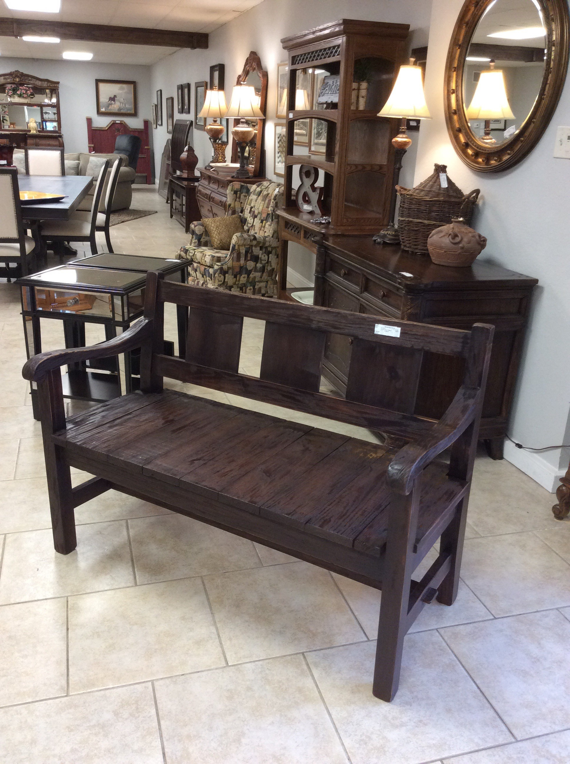 This is another lovely custom-made creation by Greg Watson! This large, roomy plank-style  bench features a dark wood stain which allows the natural wood grain to show through. Lovely enough to be used either outdoors or indoors.