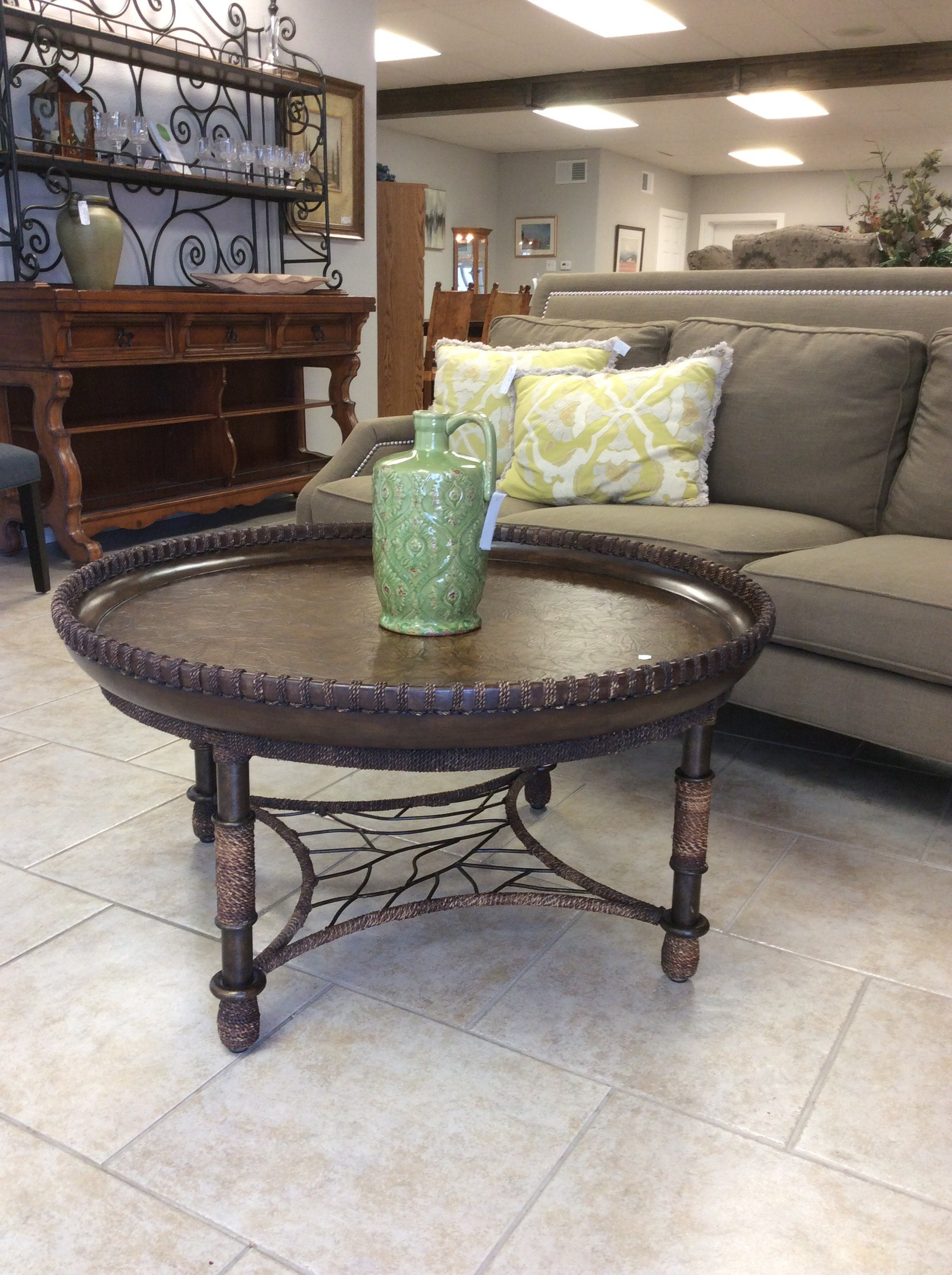 Oh,so nice!  This coffee table by Bernhardt is gorgeous, full of pesonality and character. It features a combination of metal, wood, patterned leather and rope trim on both the tabletop and the legs. Stylish and contemporary.
