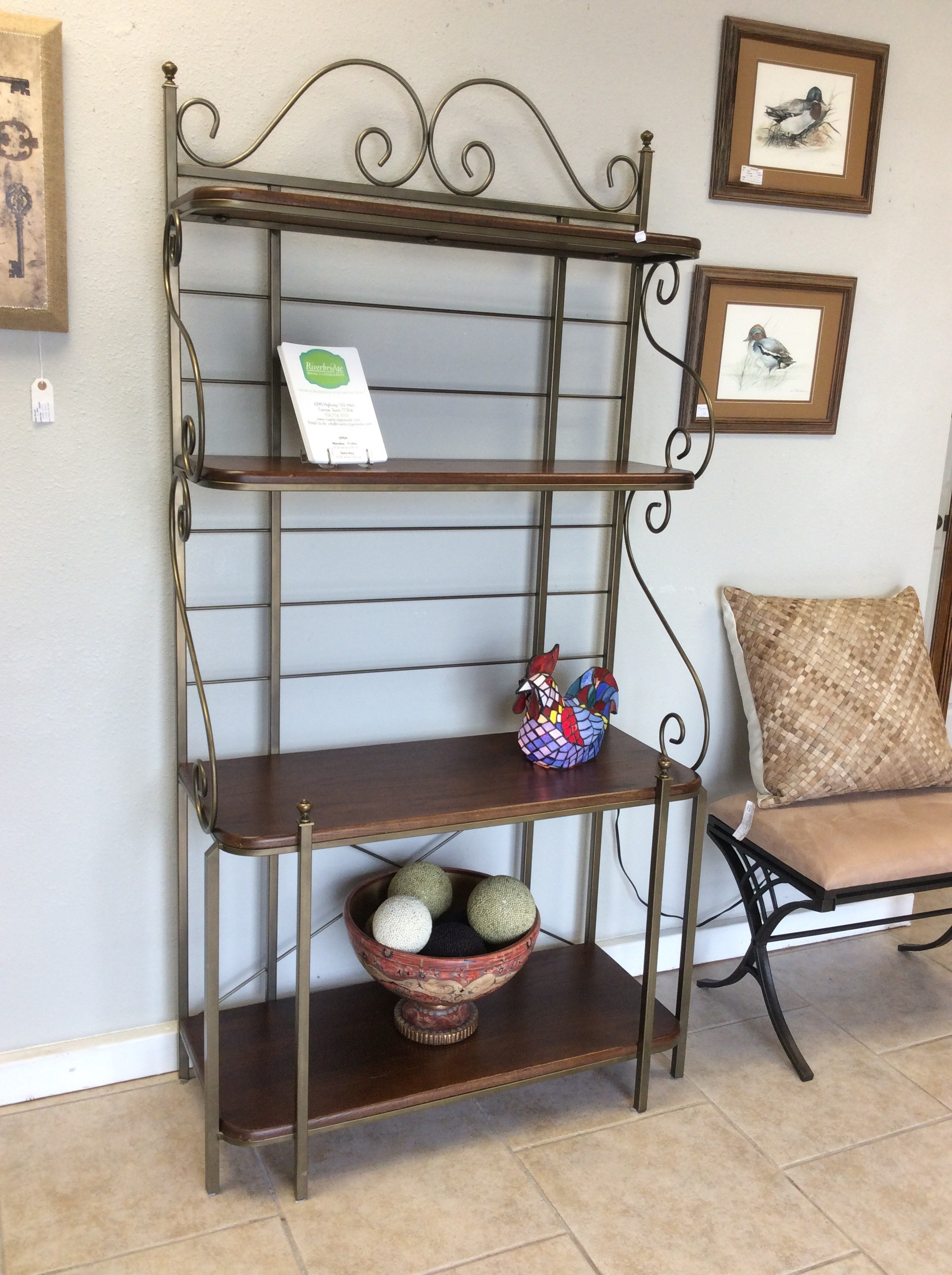 This baker's rack would be the perfect addition to your home! Simple and sweet, it's a lovely combination of metal and wood. The wood shelves have a gorgeous walnut finish and are lightly distressed. The metal frame is a burnished, slightly antiqued color giving it a vintagy look. Not a baker? Not a problem! This is highly functional and could be used for so many things only limited by your imagination. It's also priced well, come in soon and take a look!