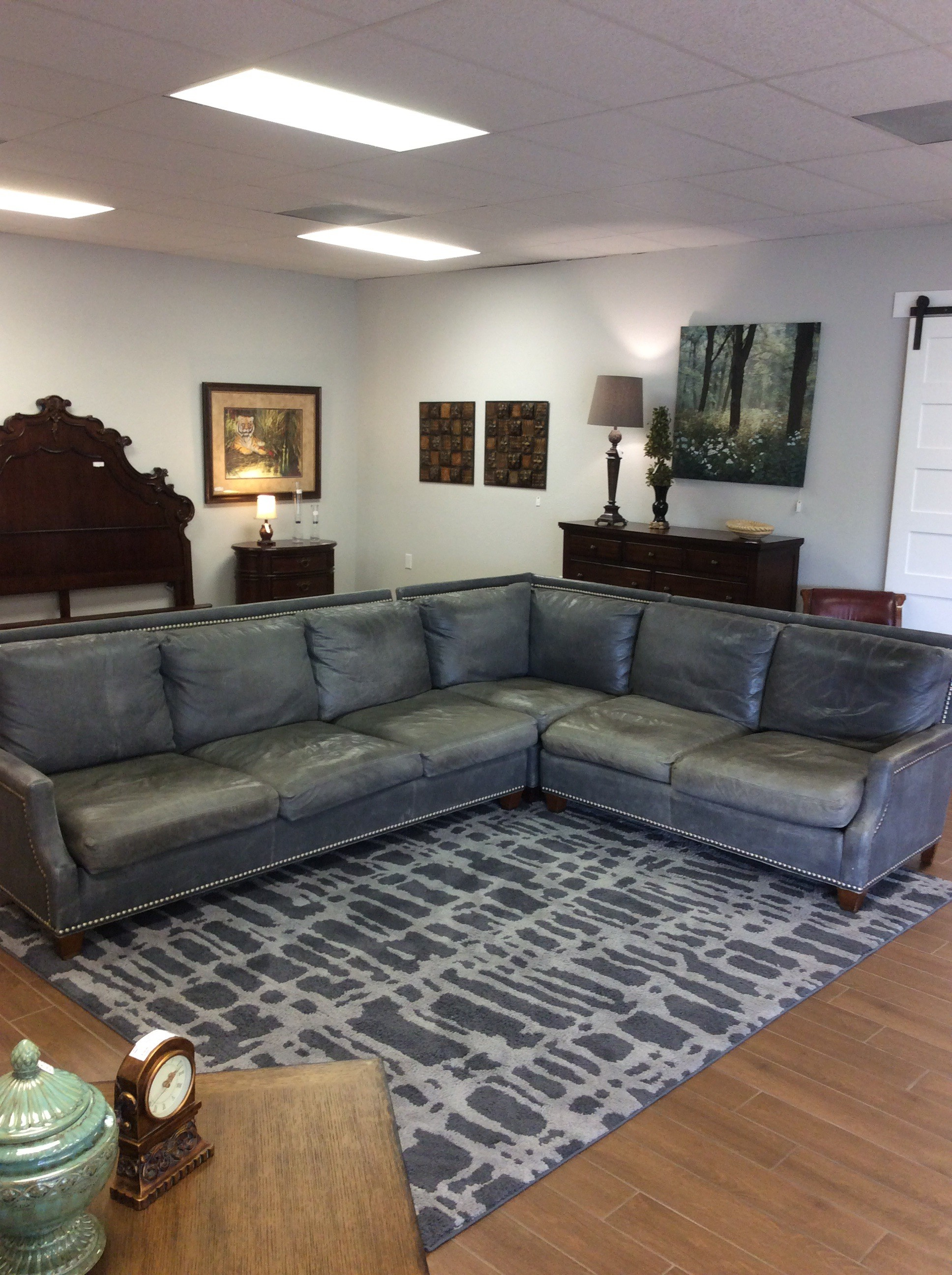 BARGAIN ALERT!!!! This enormous 3-piece SHERRILL leather sectional is in fair condition. The leather has many worn and faded areas, hence the low price. The seat cushions are all removable, while the back cushions are not. There are nailhead accents, as well. Priced to move at only $595!