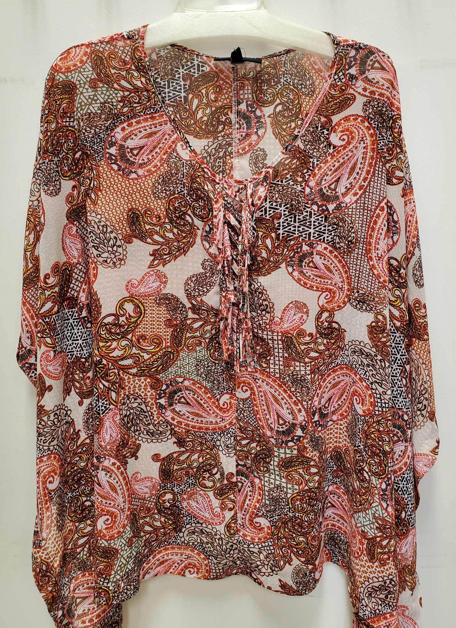 "Lane Bryant top<br /> cape style<br /> pink/gold paisley<br /> 14/16<br /> Approx. 29"" in length"
