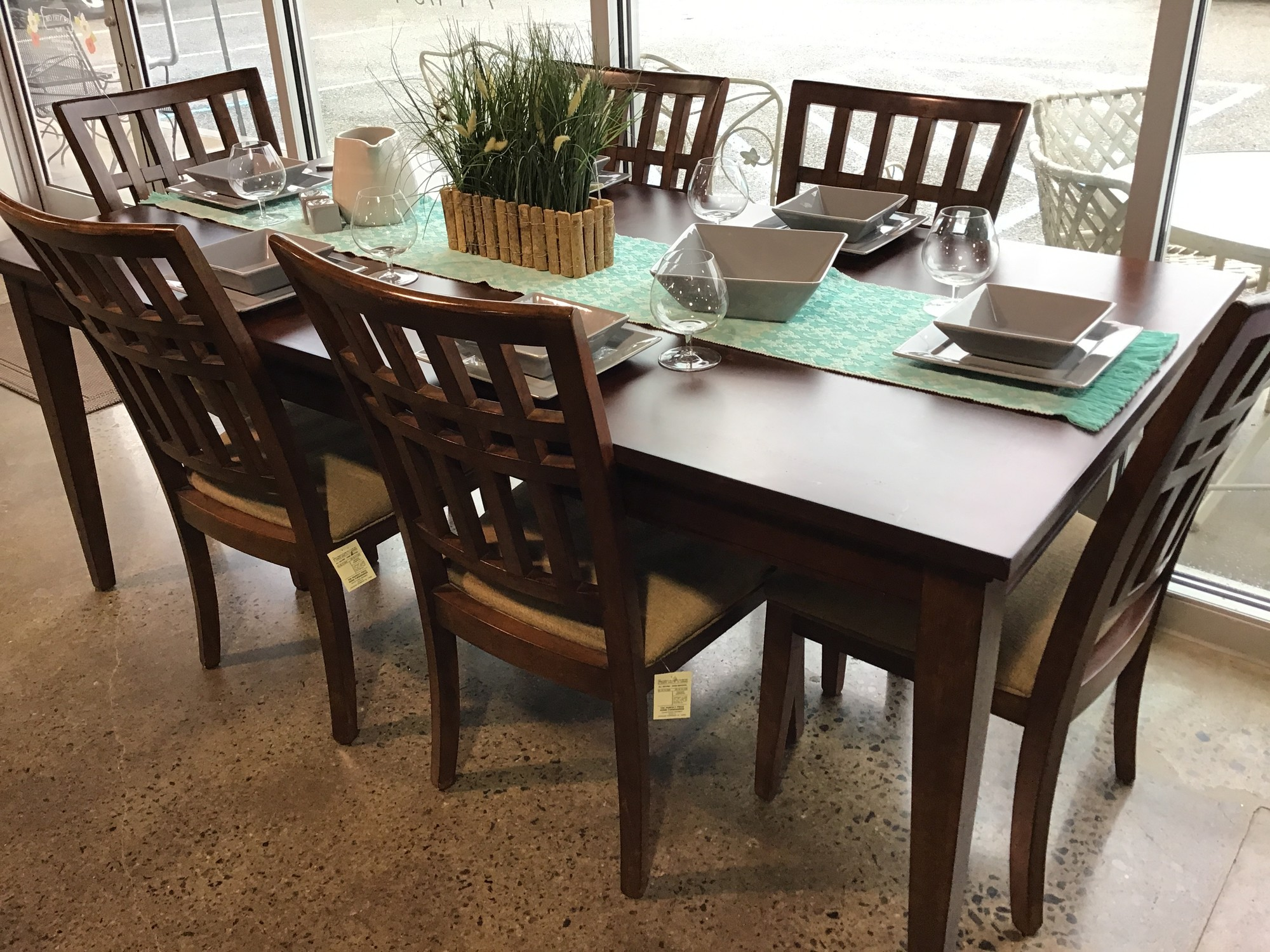 "This rectangular dining room table can comfortably seat 6-8 people and comes with 6 upholstered chairs. It can be used with our without the leaf, depending on the size of your room. The chairs are upholstered in a neutral tan fabric on the seats with a wooden back. The set is from Legacy Classics Furniture.<br /> Dimensions without leaf are 60"" x 40"" x 30""<br /> Dimensions with leaf are 78"" x 40"" x 30"""