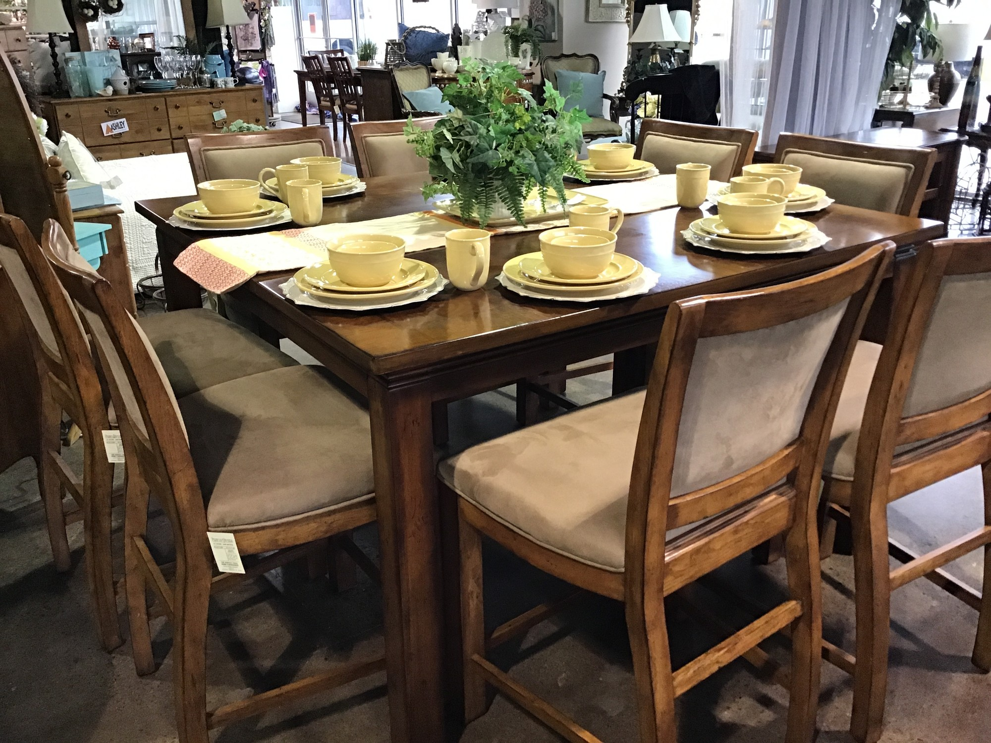 "This large counter-height table comes with 8 large upholstered chairs and 1 - 18"" leaf that makes the table square when inserted. The chairs are upholstered in a light tan/taupe and are quite wide.<br /> Dimensions without leaf are 60"" x 42"" x 36""<br /> Dimensions with leaf are 60"" x 60"" x 36"""