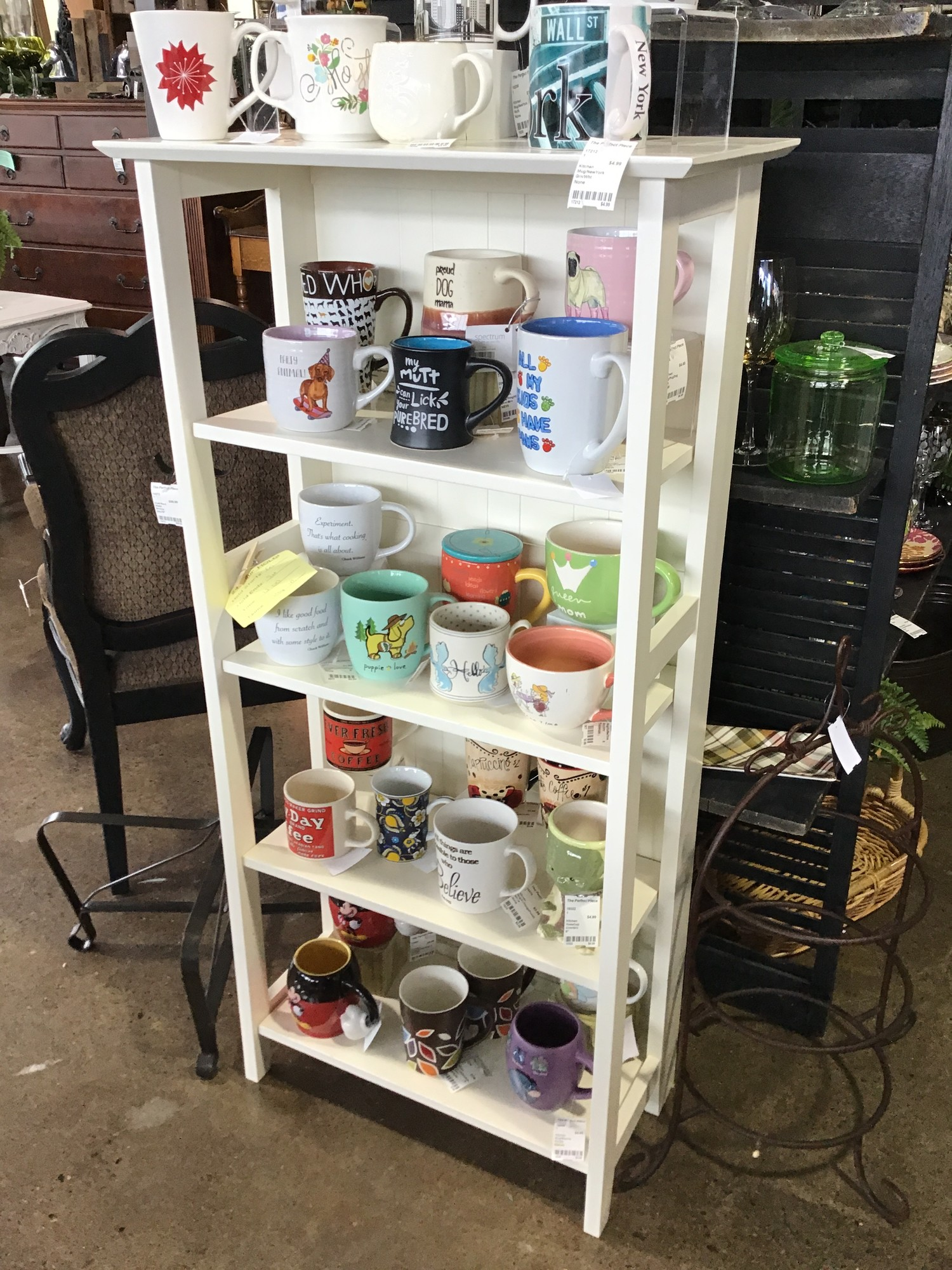 "This white bookcase has a small footprint, so perfect for the smaller space! It can fold up for easy transport and is painted white.<br /> Dimensions are 23-1/2"" x 13-1/2"" x 48"""