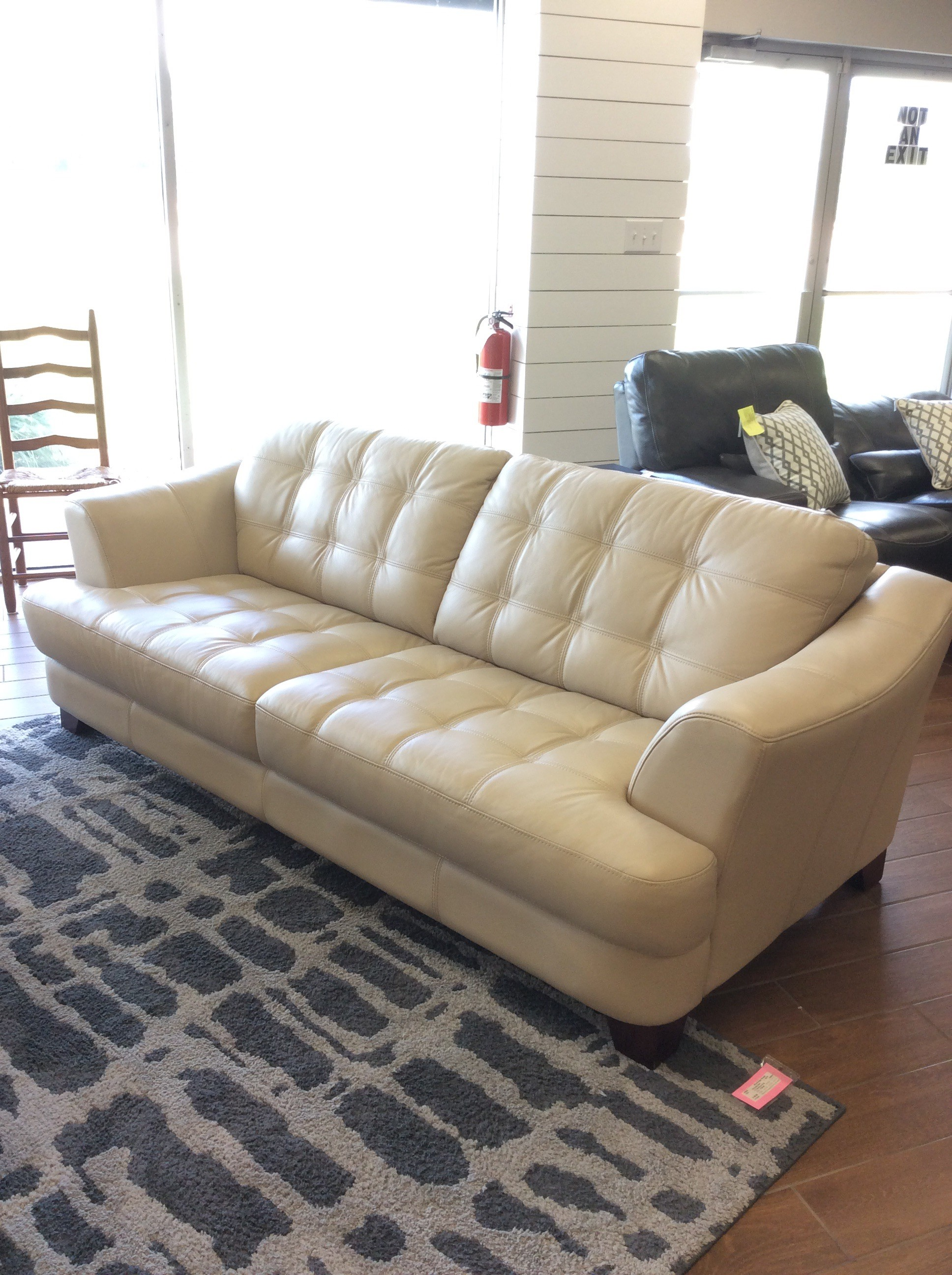This sofa is deliscious! Modern and sleek, it's in perfect condition and priced well. Upholstered in a soft, supple vanilla colored leather. All cushions are attached, tufted with ticking. What could be better than that? Two of them would be better and we have two of them! Come by soon, they won't be here long!