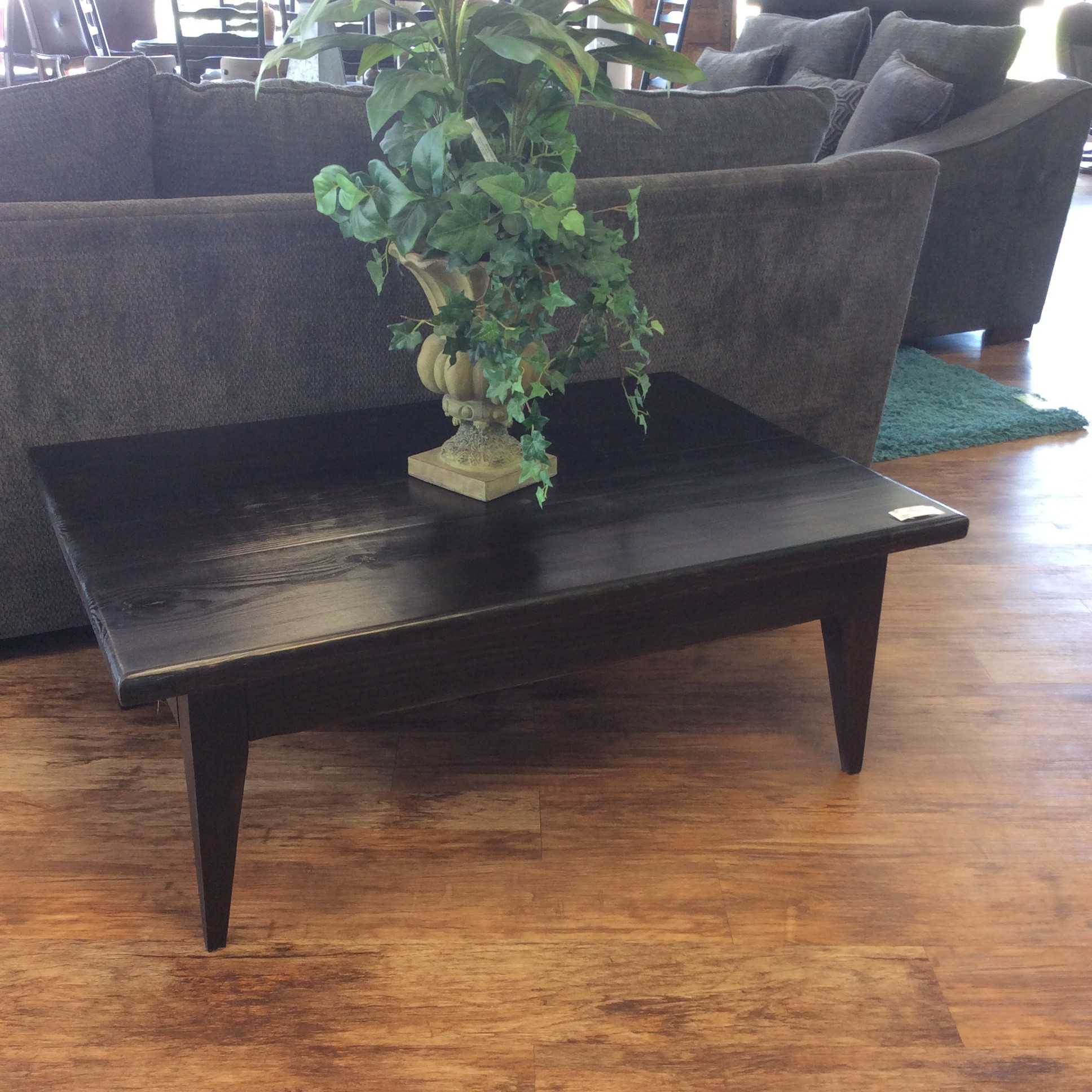 This custom-made, solid pine wood coffee table is another exciting piece by Greg Watson! Jet black with a bit of brown for accent and contemporary in design - it's super stylish. Greg's furniture doesn't last here for long, so come on by and see it for yourself!