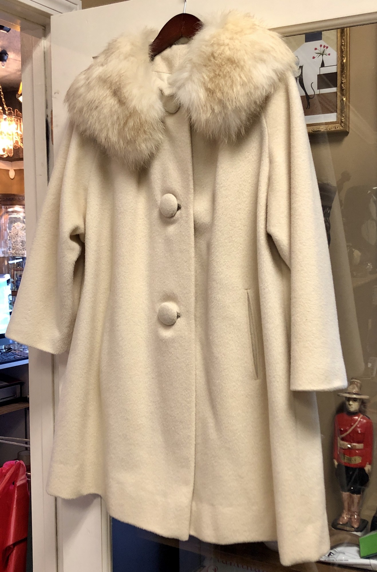 Vintage c. 1960s Cream Wool Coat with a Fur Collar.  4 big covered buttons. Very Audrey Hepburn. No size listed but it's a large, perfect for layering over a sweater this winter!