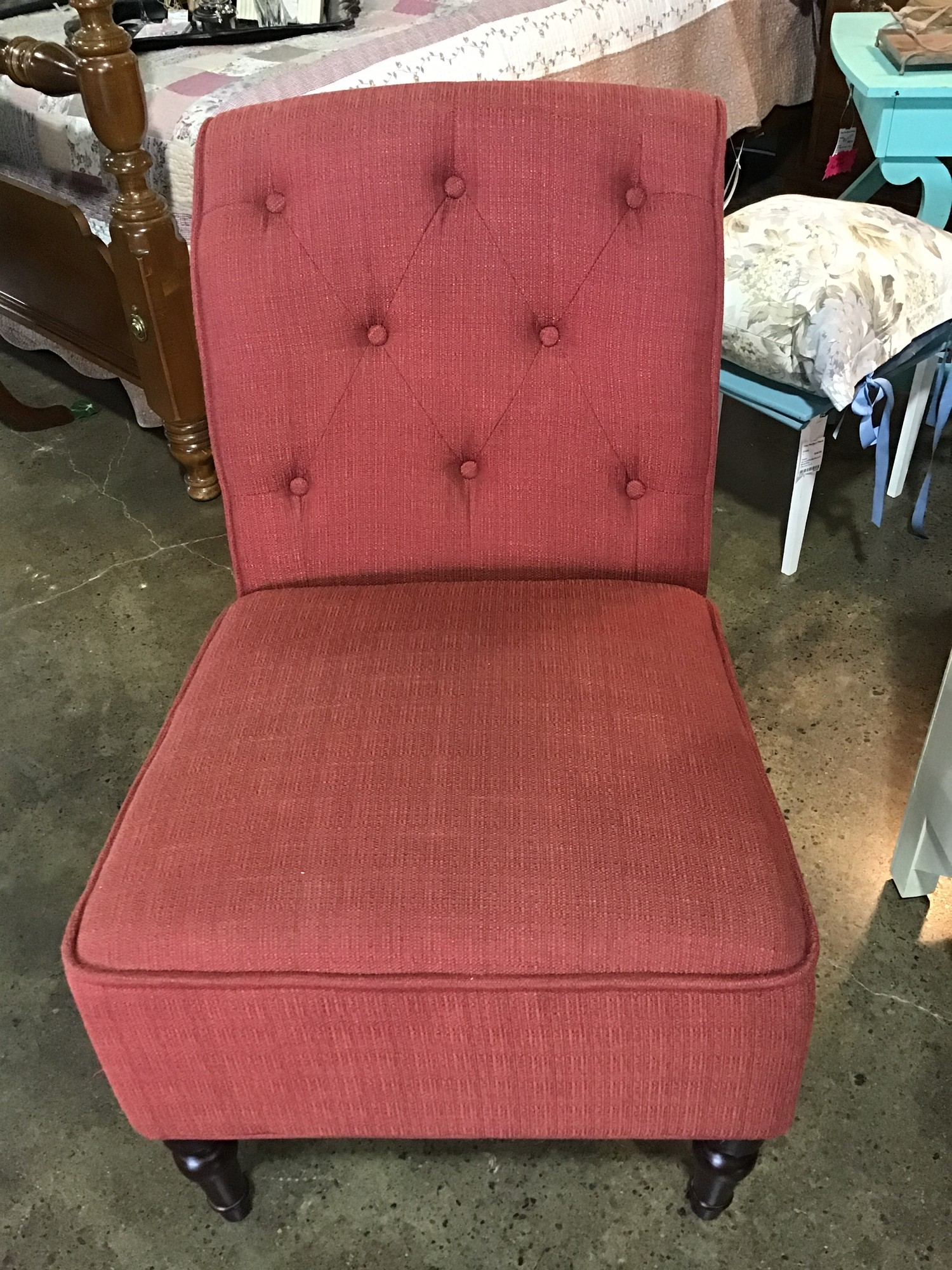 "Pretty little chair to put in a corner of the room or next to an accent table!  Upholstered in red fabric, this chair features a tufted rolled back with wooden legs.<br /> <br /> Dimensions:  23""W x 32""D x 34""H"