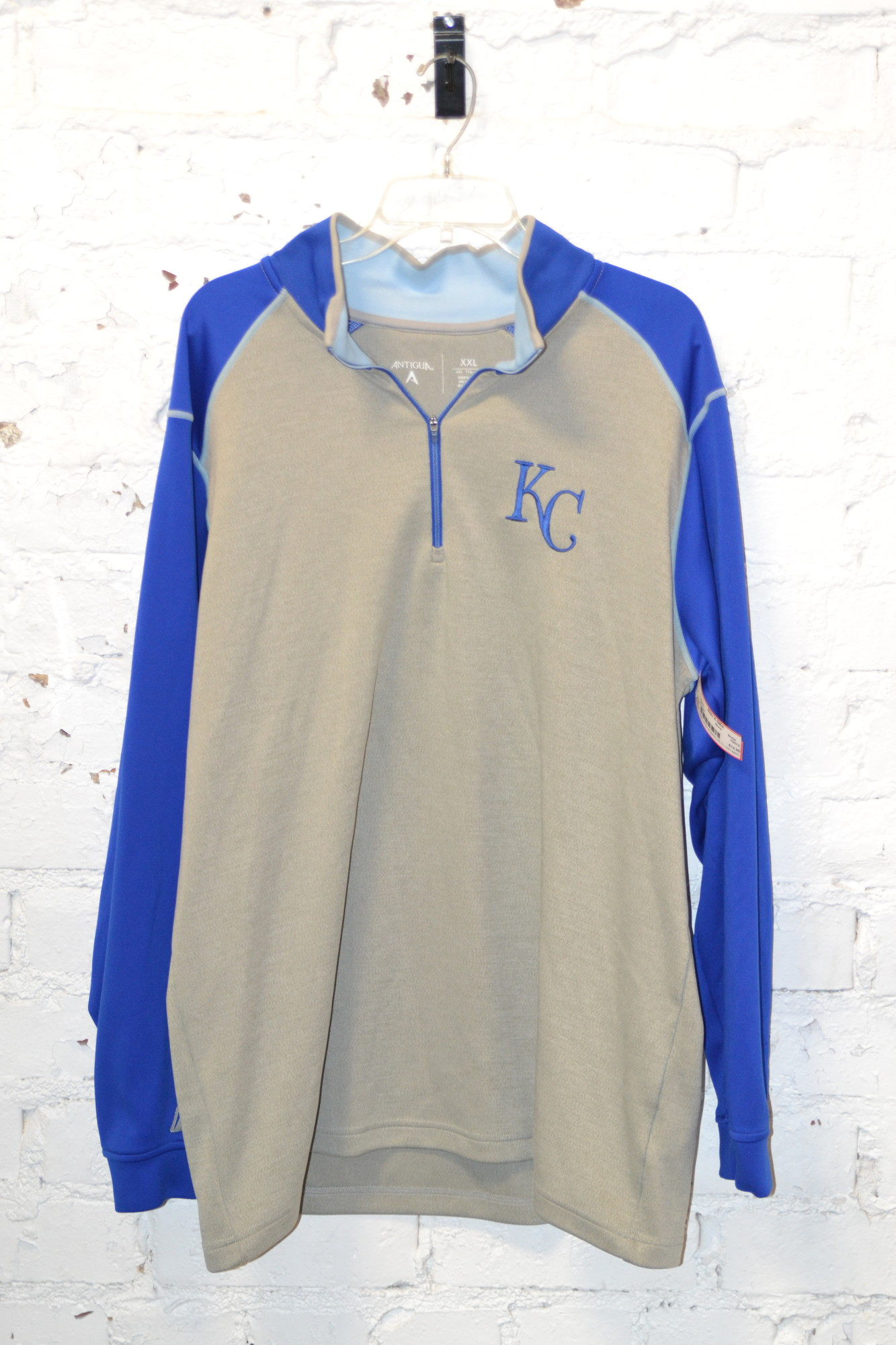 -Royals<br /> -Quarter zip<br /> -Gray with blue sleeves<br /> -Excellent condition<br /> -Size XXL