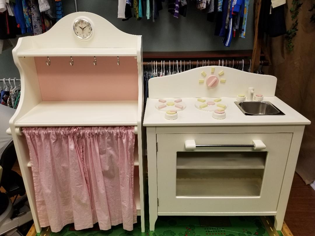 Pottery Barn Kids 2-piece Classic Kitchen<br /> Stove/oven/sink combo with side towel bar<br /> Pie cabinet with clock & interior shelves<br /> Nice condition with minor signs of use<br /> Retired pieces, still sold elsewhere for $200+<br /> Original retail $300.00<br /> STORE PICKUP ONLY, NO SHIPPING<br /> HEAVY ITEMS, WILL NEED HELP TO LOAD