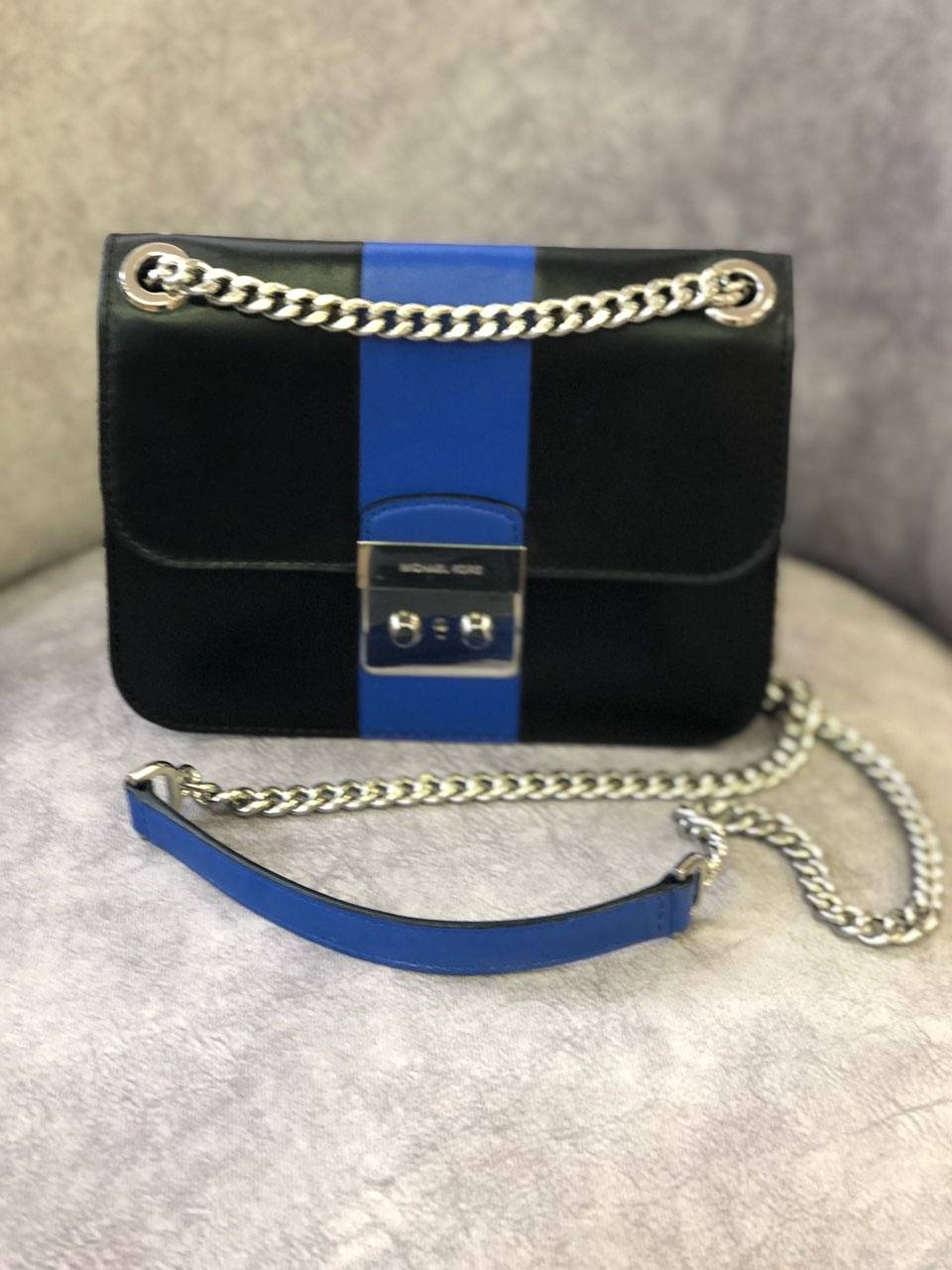 "Michael Kors, BlueBlk, Authentic<br /> SHOW YOUR SUPPORT FOR LAW ENFORCEMENT<br /> Black and Blue Stripe Leather Cross Body Bag<br /> SIZE:  8""L x 2""W x 6""H<br /> Est. Retail Price: $300.00<br /> CONDITION:  Pre-owned<br /> This item may has been worn but has little visible signs of wear.<br /> Stuffing and white drawstring bag come with it.<br /> I love this handbag!<br /> A Great bag to carry and support our law enforcement officers."