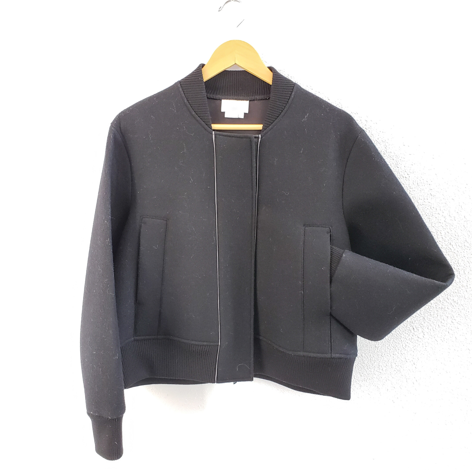 DKNY Pure<br /> Black Jacket<br /> Size Large<br /> 60% Wool 20% Viscose 20% 20% Polyester<br /> Zip and Snap closures