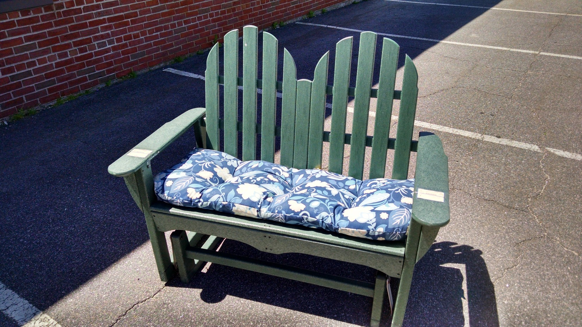 An Adirondack Glider in all weather extruded viynl wood similar to all weather deck material. Super well made, will last outdoor for years. Glide on in and check it out!